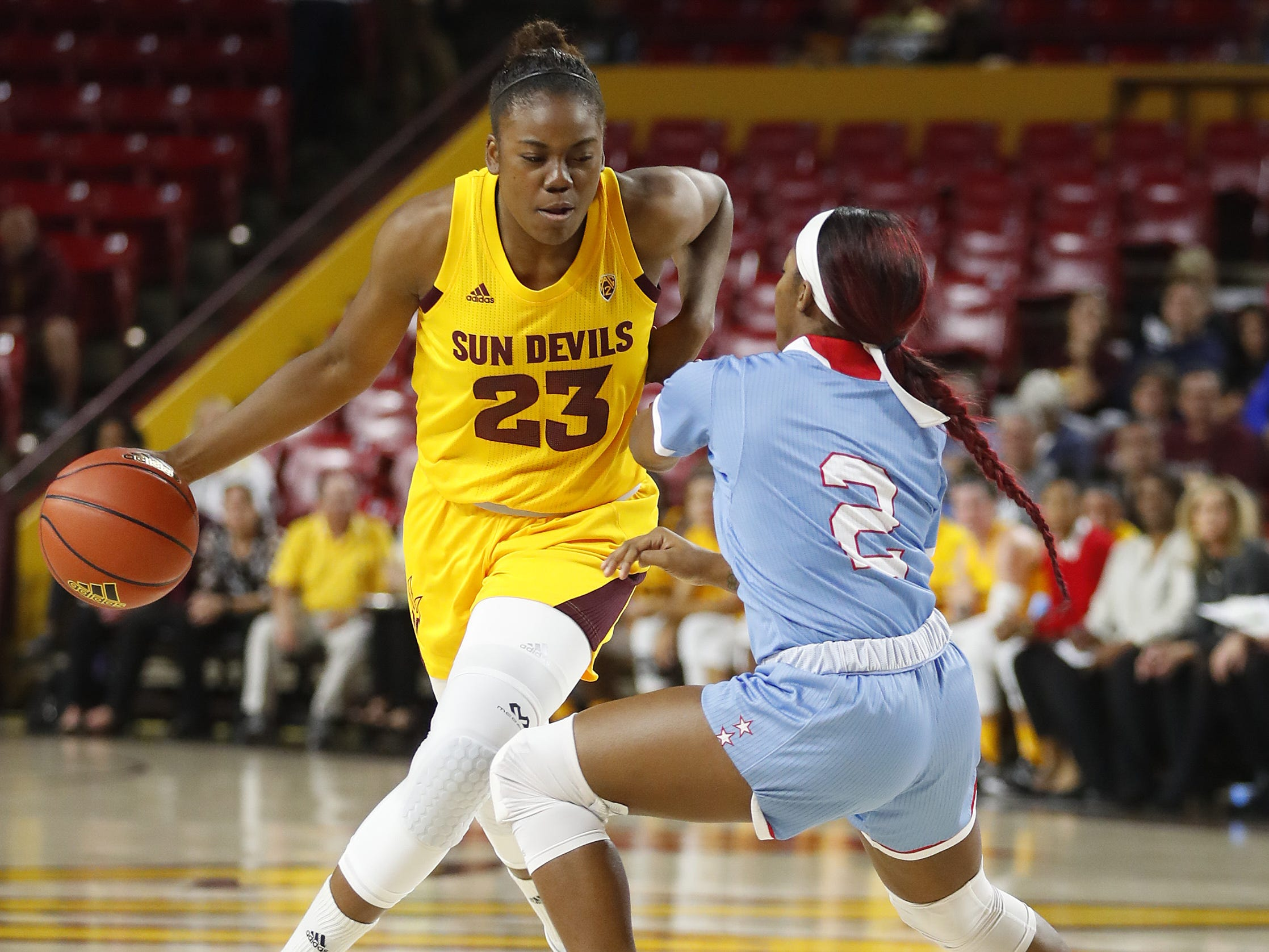 ASU's Iris Mbulito (23) drives the lane against Louisiana Tech's Keiunna Walker (2) during the first half at Wells Fargo Arena in Tempe, Ariz. on November 30, 2018.