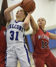 Hannah Woelfling goes up for a bucket inside against McCaskey last season.