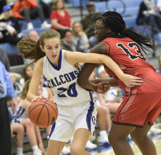 Reese Glover (20)  scored 11 straight points in one stretch in the second half to help Cedar Crest beat Wilson 48-41 Thursday night and clinch a state playoff berth.