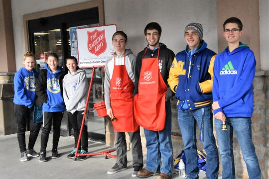 Members of the Northern Lebanon Cross Country team volunteered to ring the Salvation Army bell at BG's in Jonestown recently. The team members signed up for shifts throughout the day. Pictured , from left, are Alyssa Marlowe, Madison Bomgardner, Hanna Wanyo, Jacob Beidler, Brandon Bomberger, Jordan Berger, and Matthew Getz.