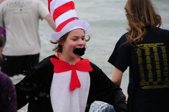Aiden Burke exits Lake Huron during the Kiwanis Polar Bear Plunge on Saturday, Dec. 1, 2018 at Lakeside Beach in Port Huron.
