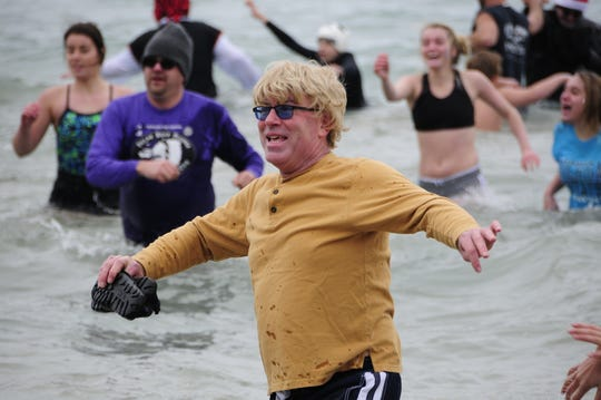 Jeff DeBell leaves Lake Huron during the Kiwanis Polar Bear Plunge on Saturday, Dec. 1, 2018 at Lakeside Beach in Port Huron.
