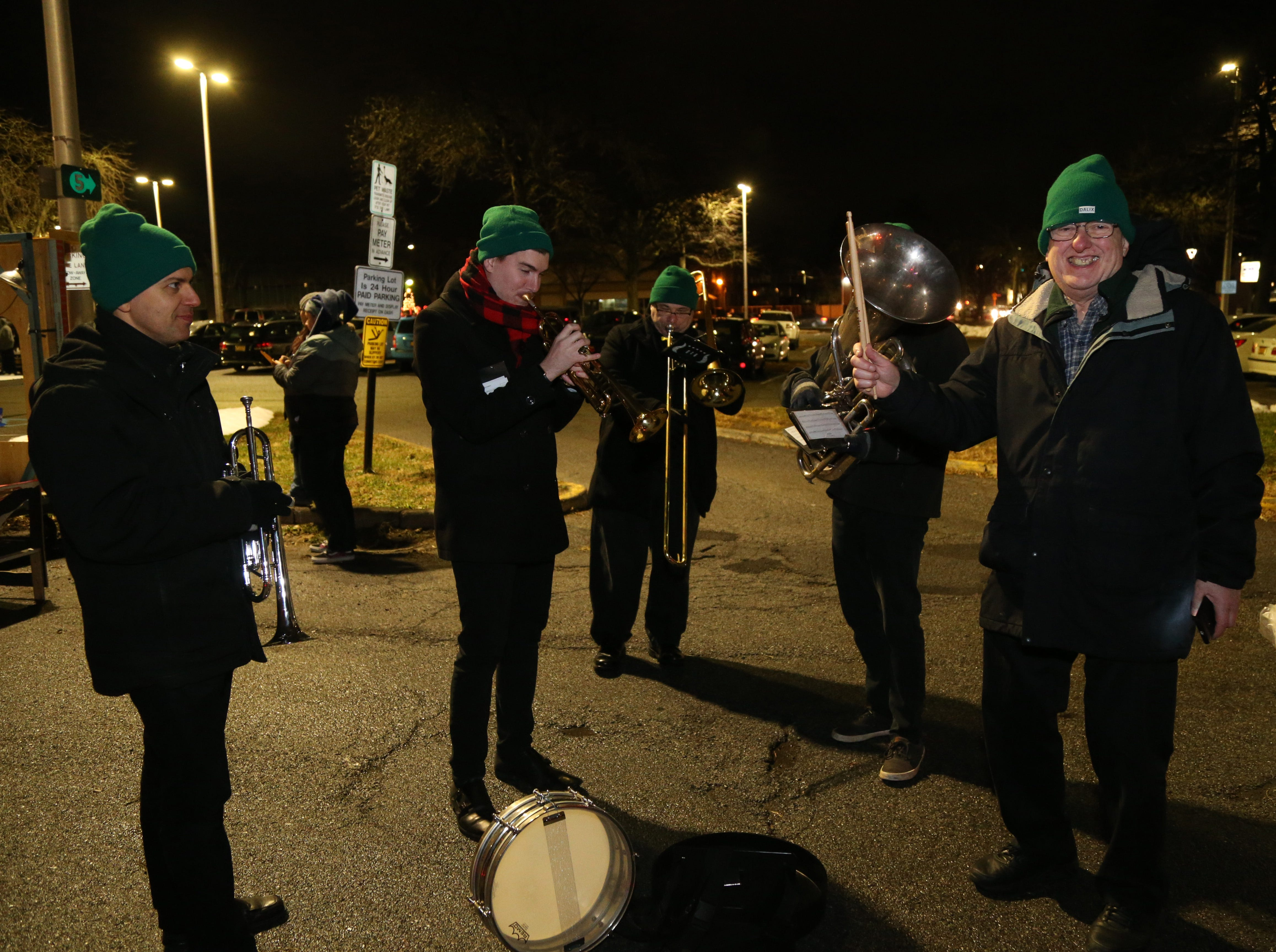 The Wholly Brass Band warm up before the Celebration of Lights in the City of Poughkeepsie on November 30, 2018.