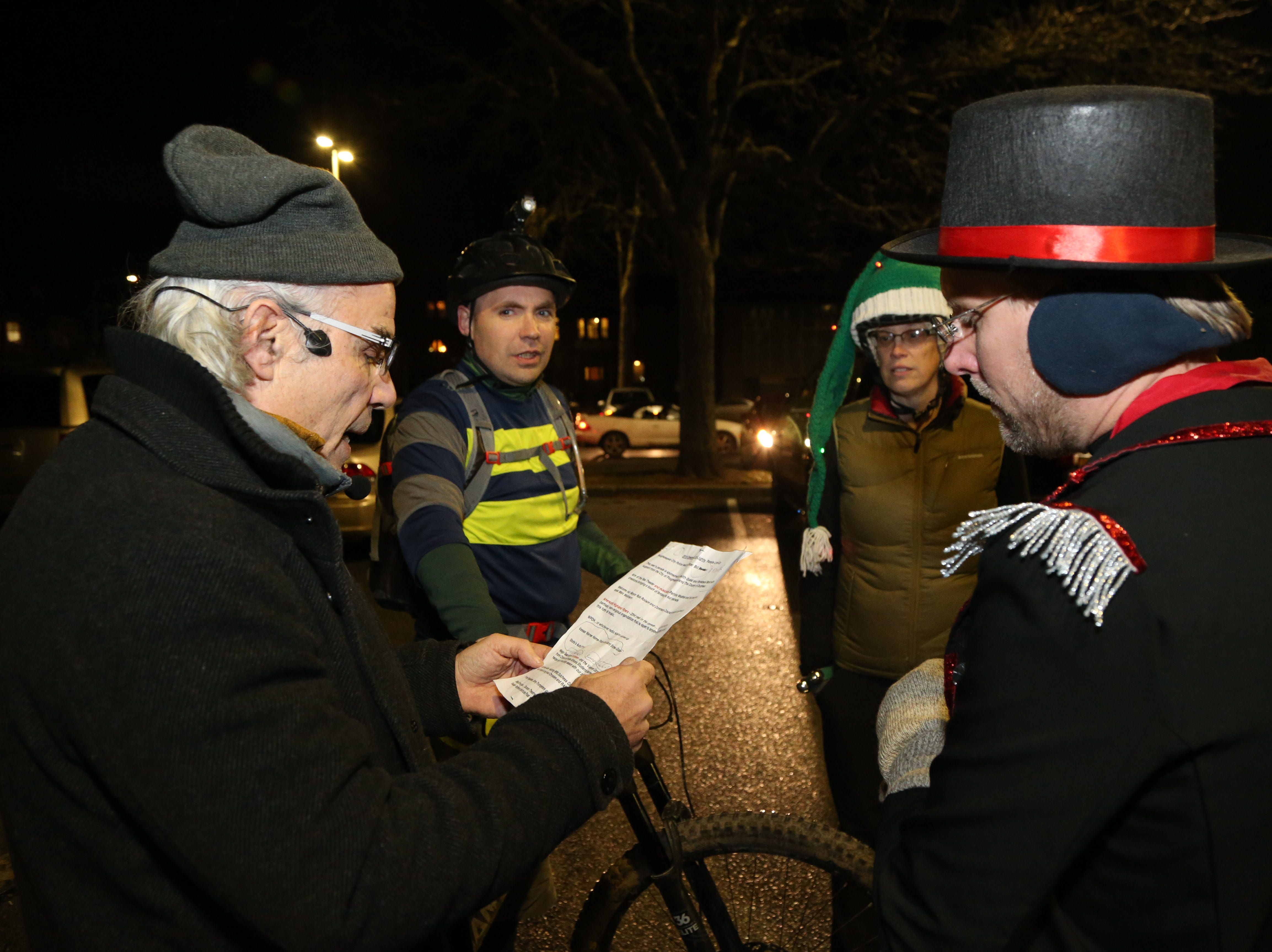 Bardavon executive director Chris Silva speaks with, representatives from the Fats in the Cats Bicycle Club, from left, Mike White, Cara Gentry and Frank Richards  before the start of the Celebration of Lights Parade in the City of Poughkeepsie on November 30, 2018.