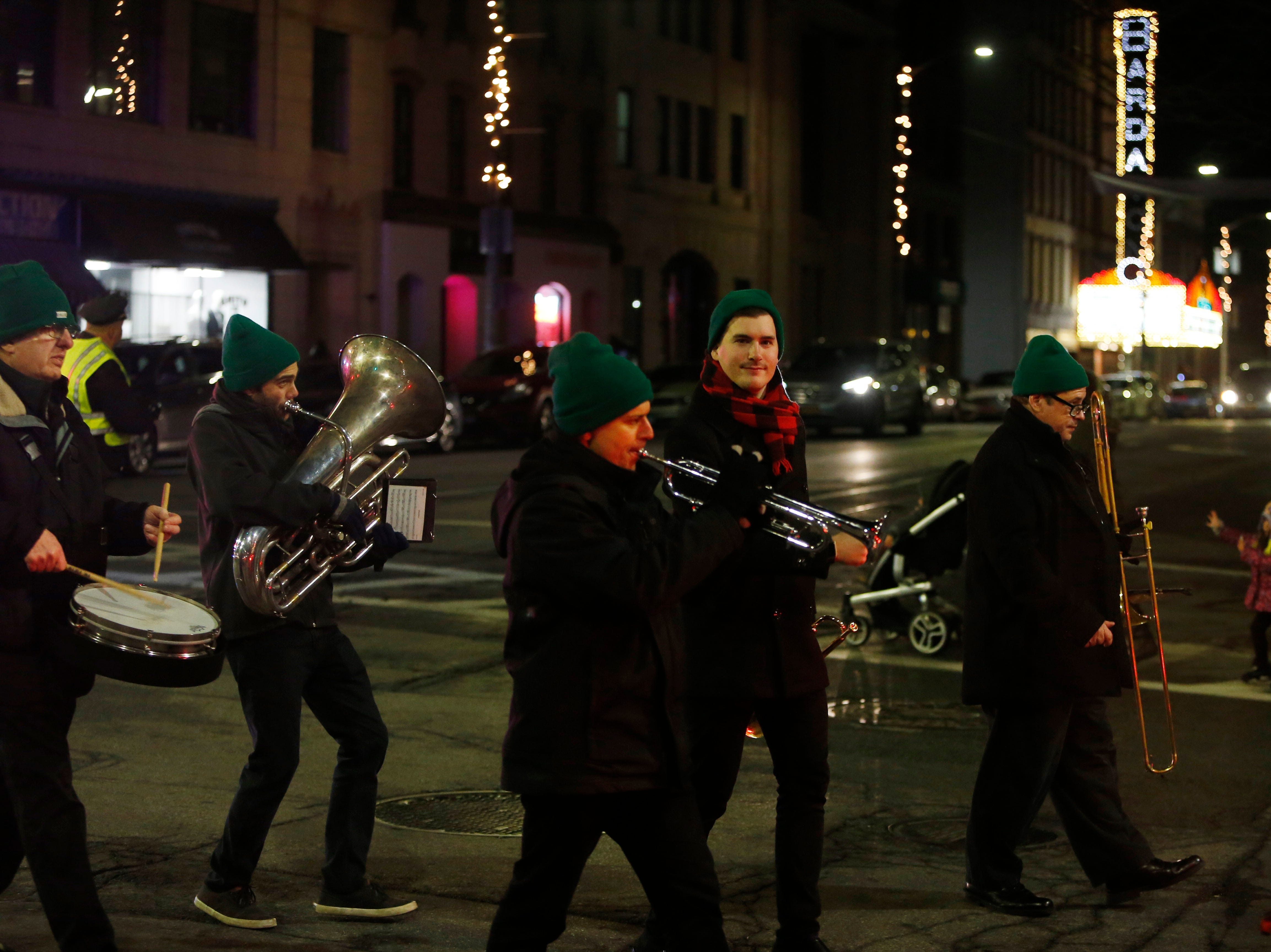 The Wholly Brass Band performs during the Celebration of Lights Parade in the City of Poughkeepsie on November 30, 2018.