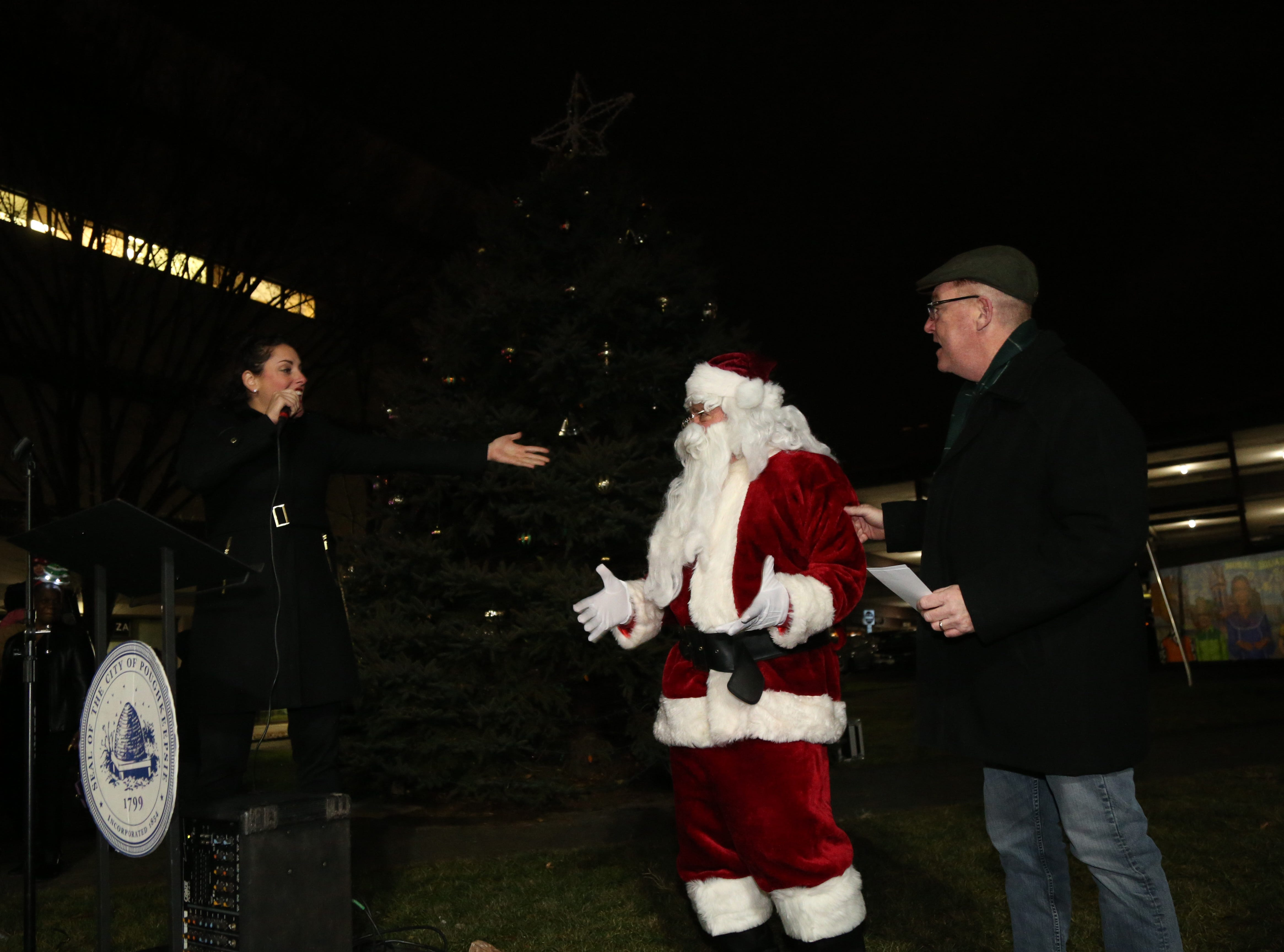 From left, Michelle Barone, Santa Claus and Mayor Rob Rolison during a tree lighting at the Celebration of Lights Parade in the City of Poughkeepsie on November 30, 2018.