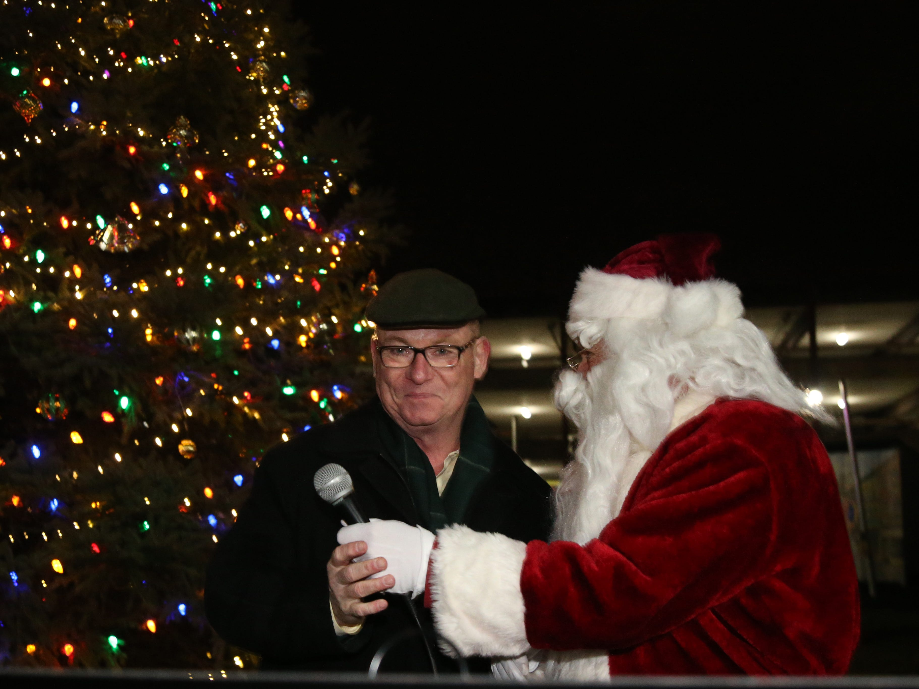 Santa Claus and Mayor Rob Rolison during a tree lighting at the Celebration of Lights Parade in the City of Poughkeepsie on November 30, 2018.