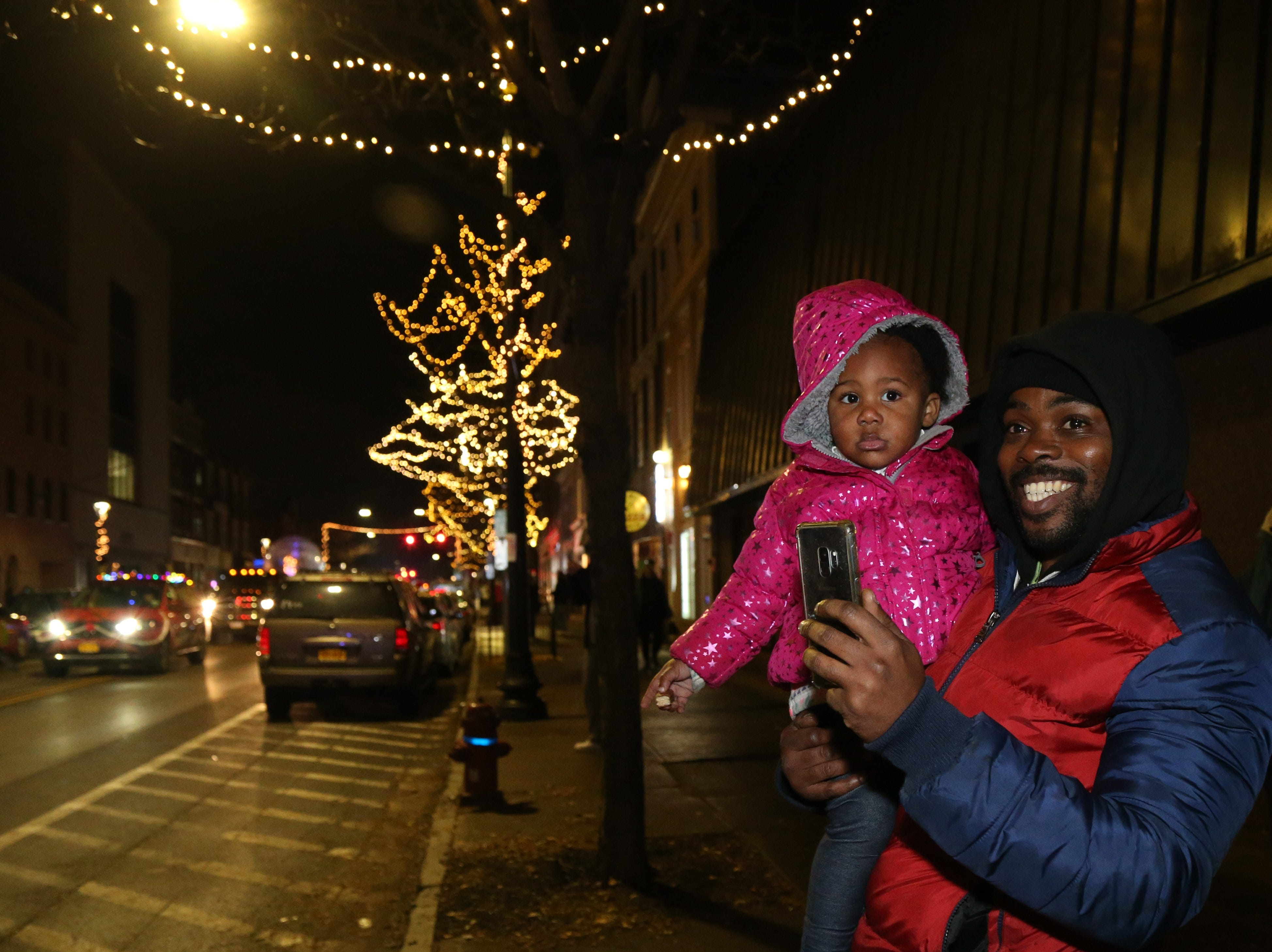 Rahman Moore and his daughter Kleio take in the Celebration of Lights in the City of Poughkeepsie on November 30, 2018.