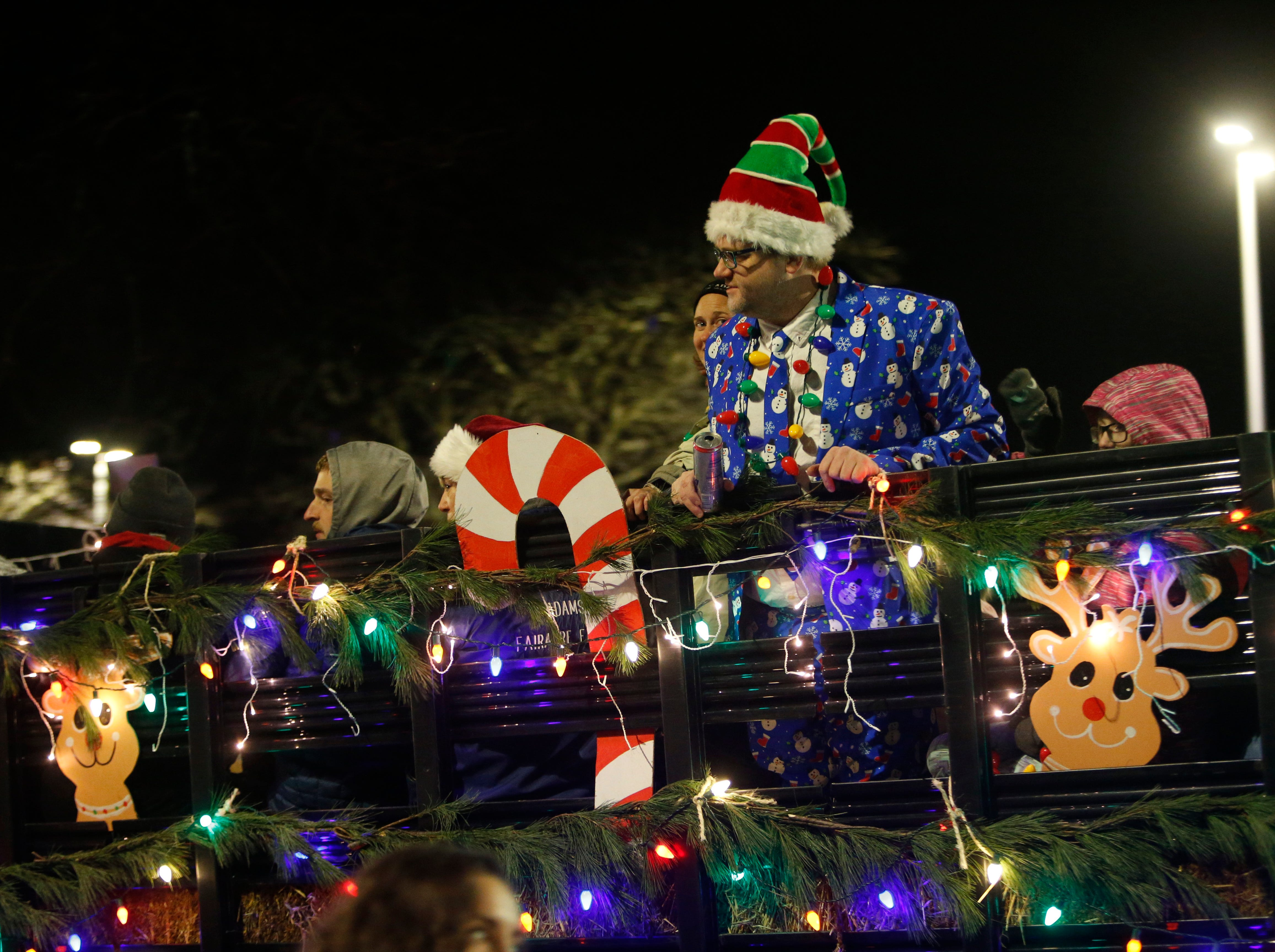 Michael Gallagher rides in the Adams Fairacre Farms truck in the Celebration of Lights Parade in the City of Poughkeepsie on November 30, 2018.