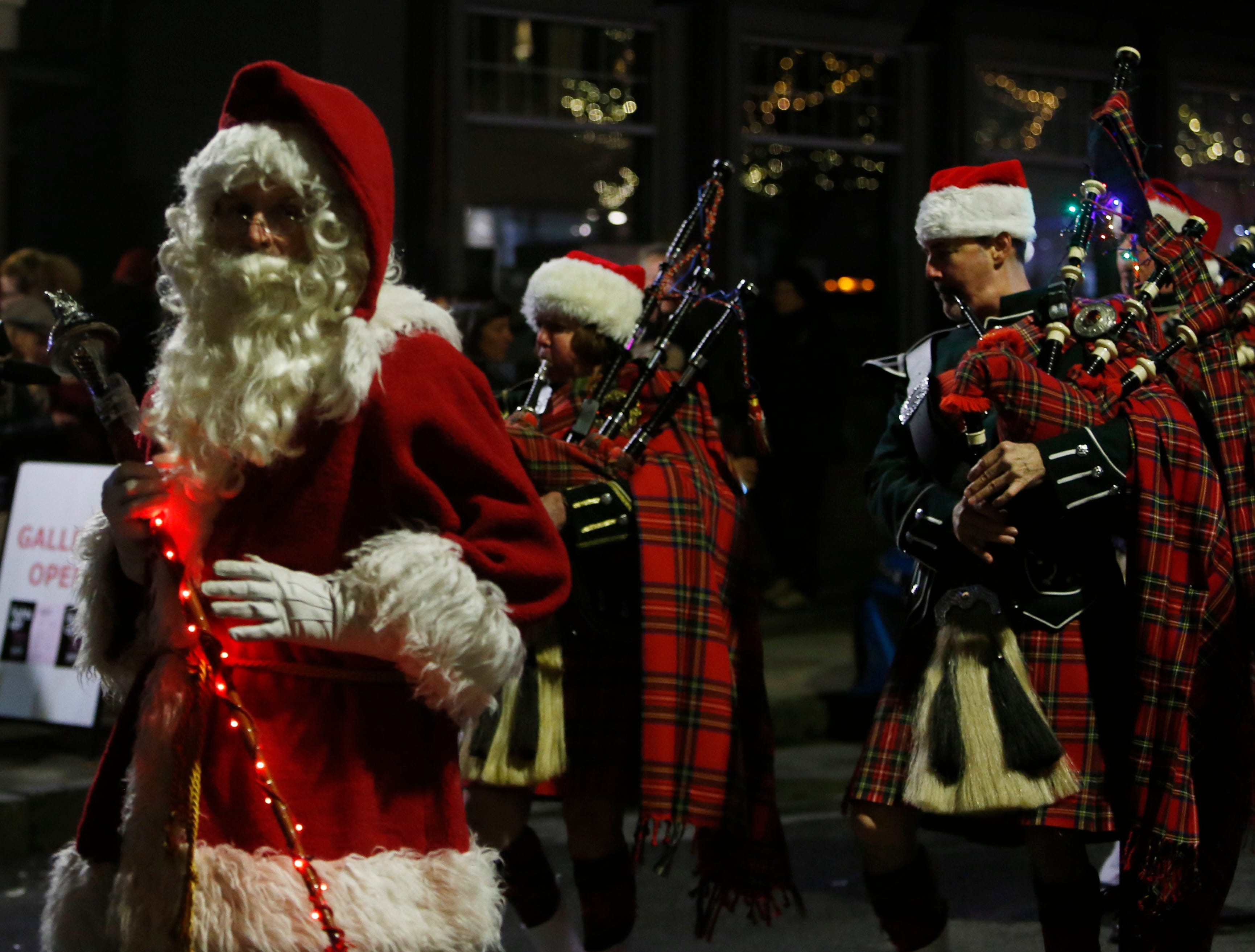 Members of the Amerscot Highland Pipe Band march in the Celebration of Lights Parade in the City of Poughkeepsie on November 30, 2018.