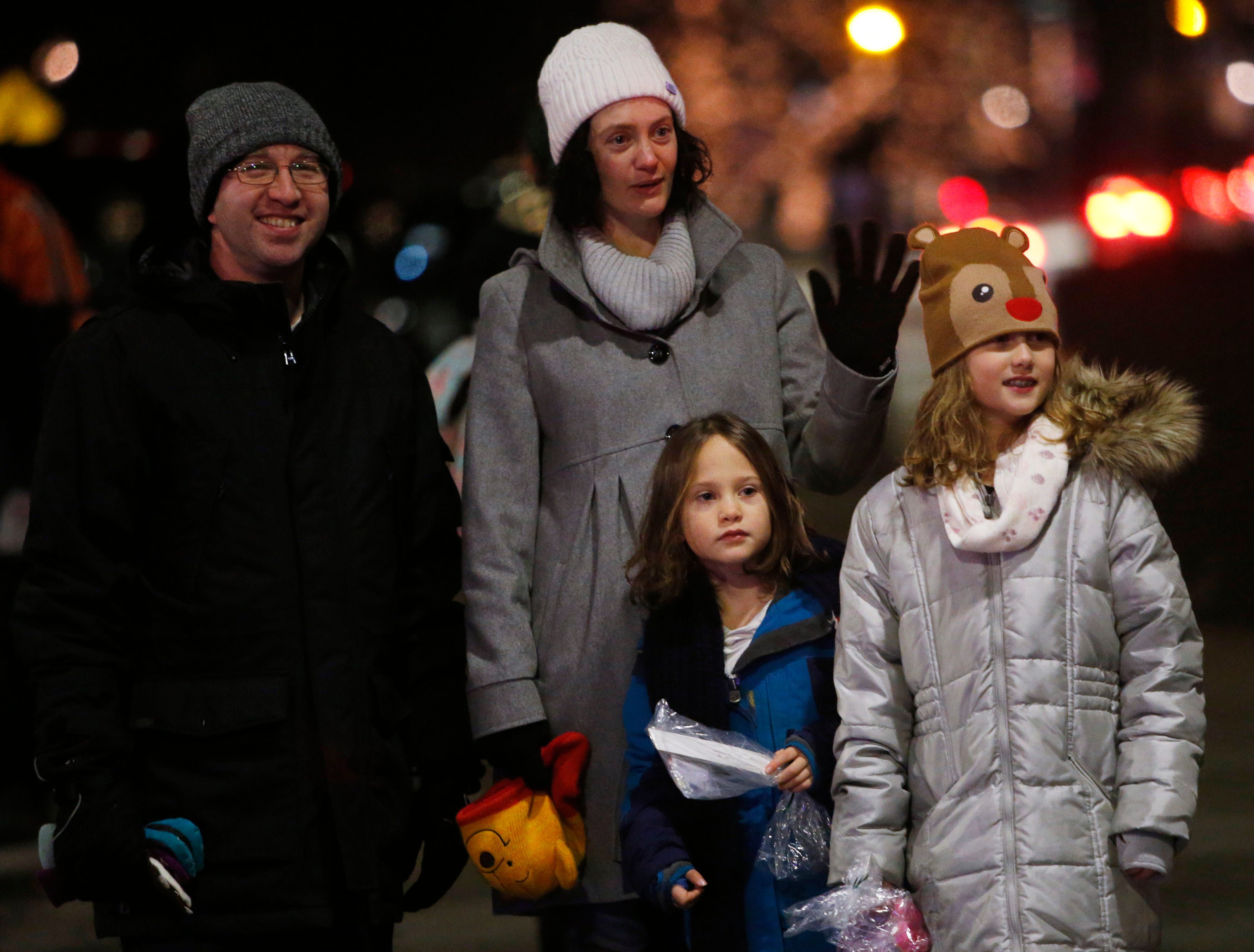 From left, Ron, Stacey, Eliza and Sophie Isaacson enjoying the Celebration of Lights Parade in the City of Poughkeepsie on November 30, 2018.