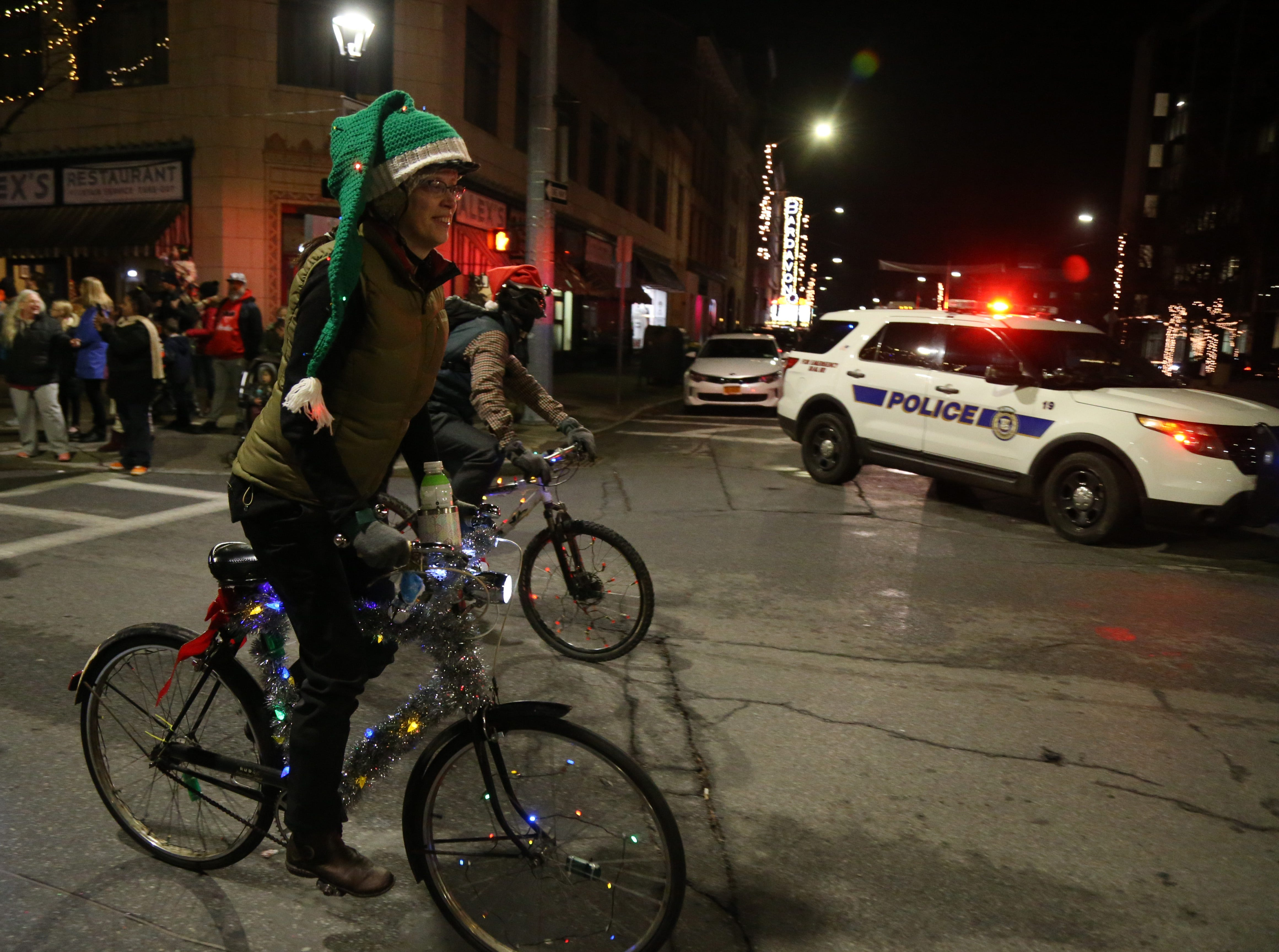 Cara Gentry of Kingston pedals through the intersection of Main Street and Market Street with the Fats in the Cats Bicycle Club during the Celebration of Lights in the City of Poughkeepsie on November 30, 2018.