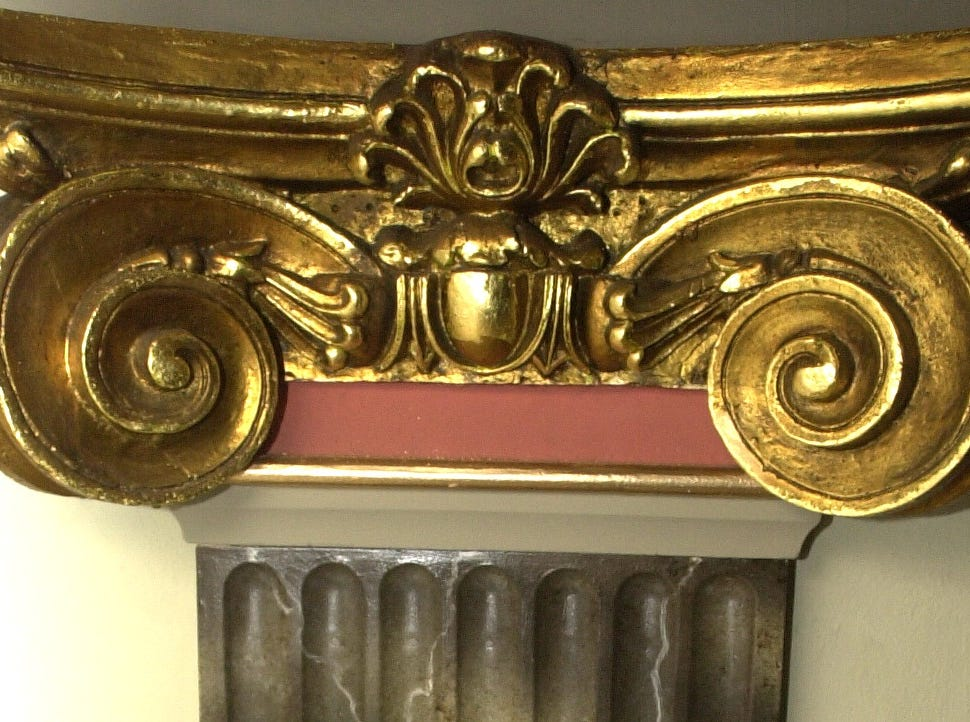 A close-up photo shows architectural detail inside Capitol Theatre.