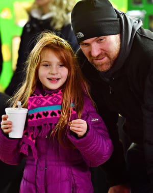 Brynn Noppenberger, 8, left, and her father John Noppenberger, both of Seven Valleys, look on at the Susquehanna Valley Garden Railway Society exhibit during Christmas Magic at Rocky Ridge County Park in Springettsbury Township, Friday, Nov. 30, 2018. Dawn J. Sagert photo