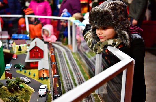 Luka Bajlovic, 9, of Manheim Township, watches the model trains exhibit by Stillmeadow Crossing Modular Train Group during Christmas Magic at Rocky Ridge County Park in Springettsbury Township, Friday, Nov. 30, 2018. Dawn J. Sagert photo