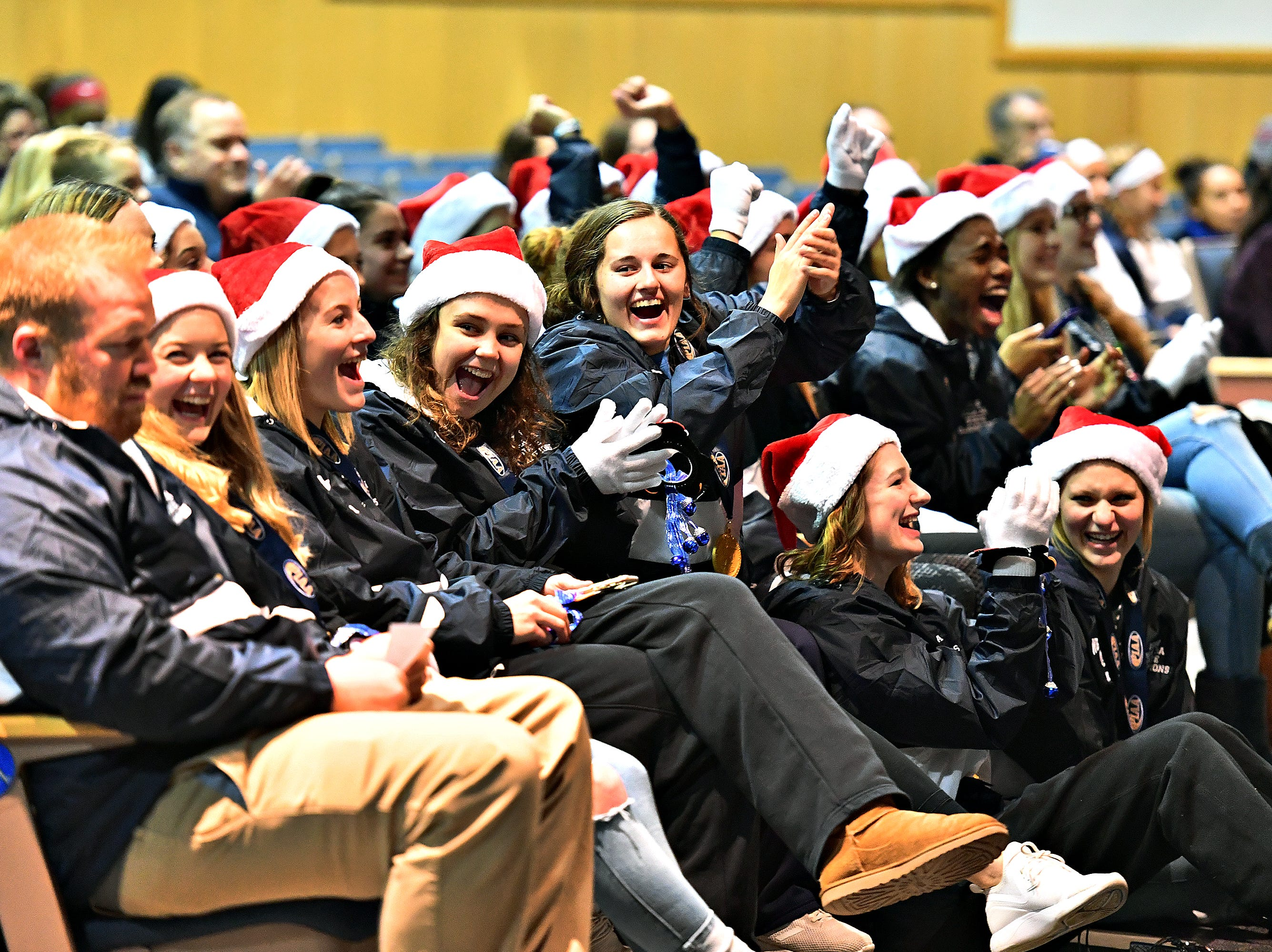 The 2018 PIAA 3-A State Champion Lady Bulldogs Volleyball team react to a video made for them as they are honored following a parade at West York Area High School in West Manchester Township, Friday, Nov. 30, 2018. Dawn J. Sagert photo