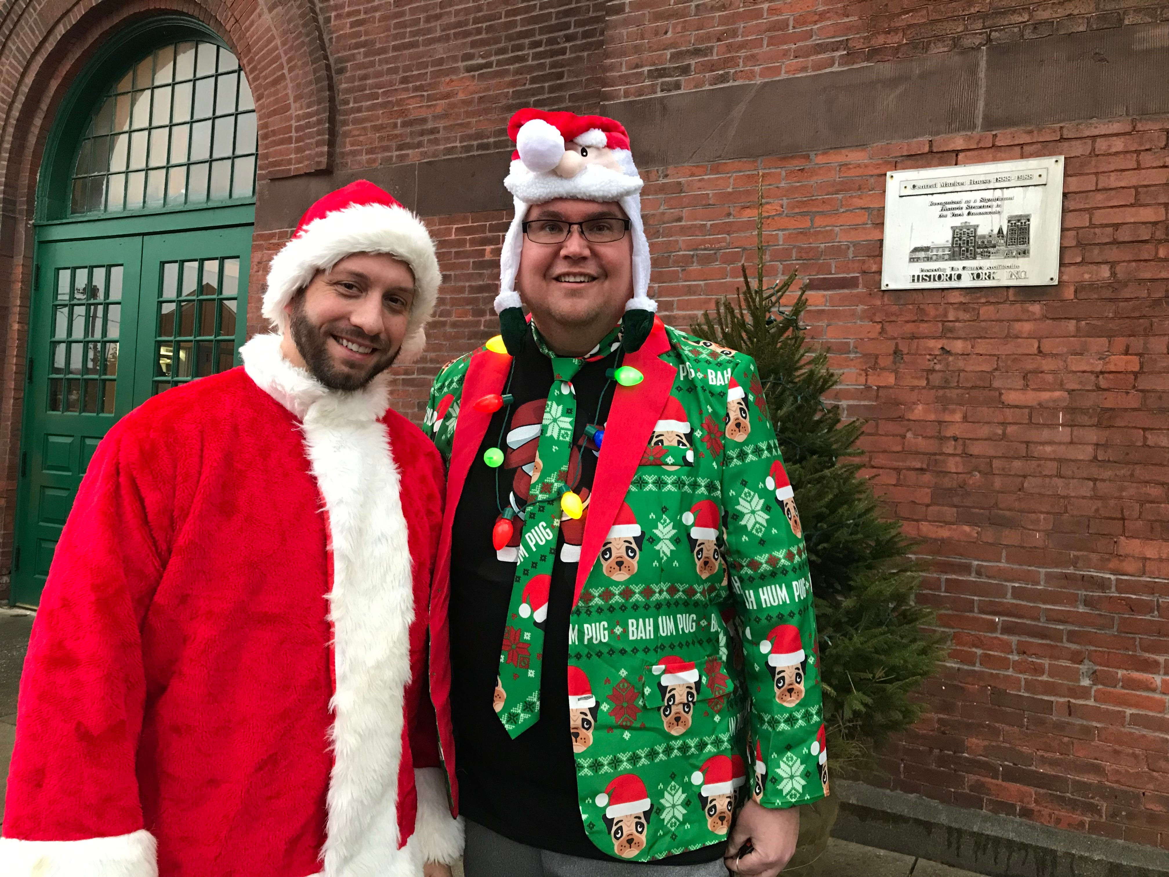 Ben Guerin of Bethlehem (left) and Bill Walter of York showcase some holiday spirit during Light Up Night in downtown York on Dec. 1, 2018.