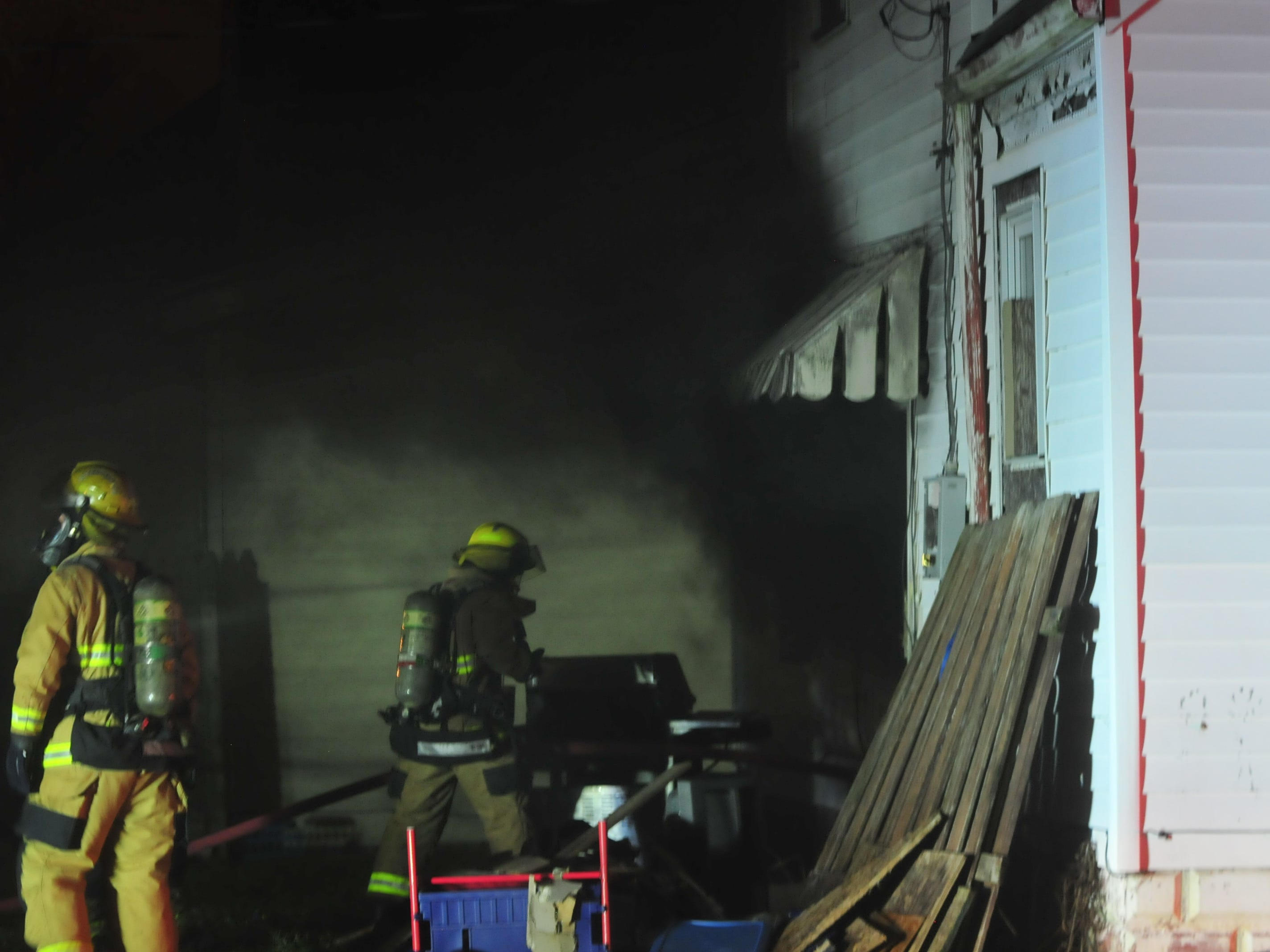 A trash fire in the basement of a vacant house on South 11th Street sent heavy, black smoke into the night Friday.