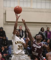 McQuaid's Kobe Long shoots over Edison defender Kevin Jackson (3).
