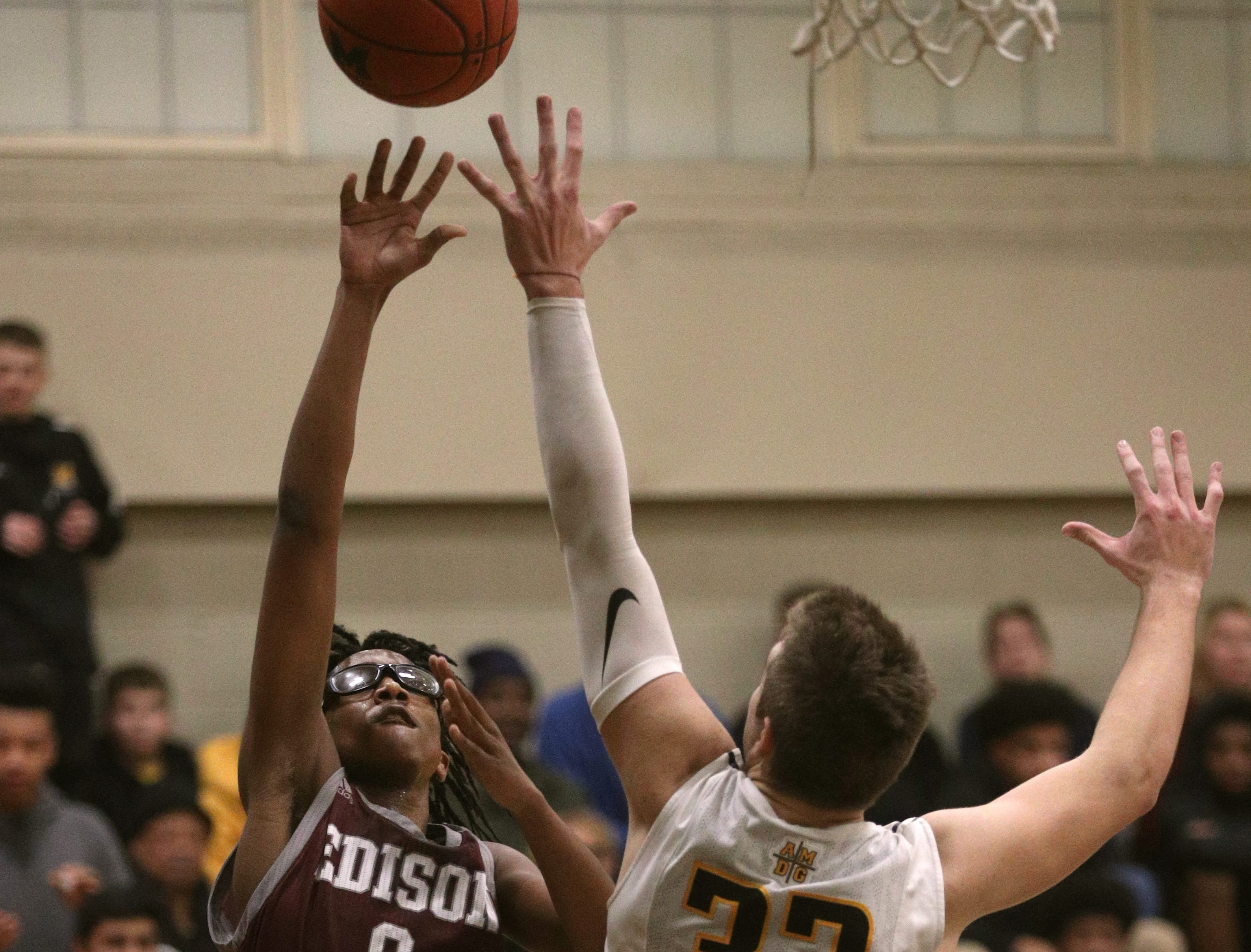 Edison's Jawaun Holt (0) lofts a shot over McQuaid's Connor Zamiara.