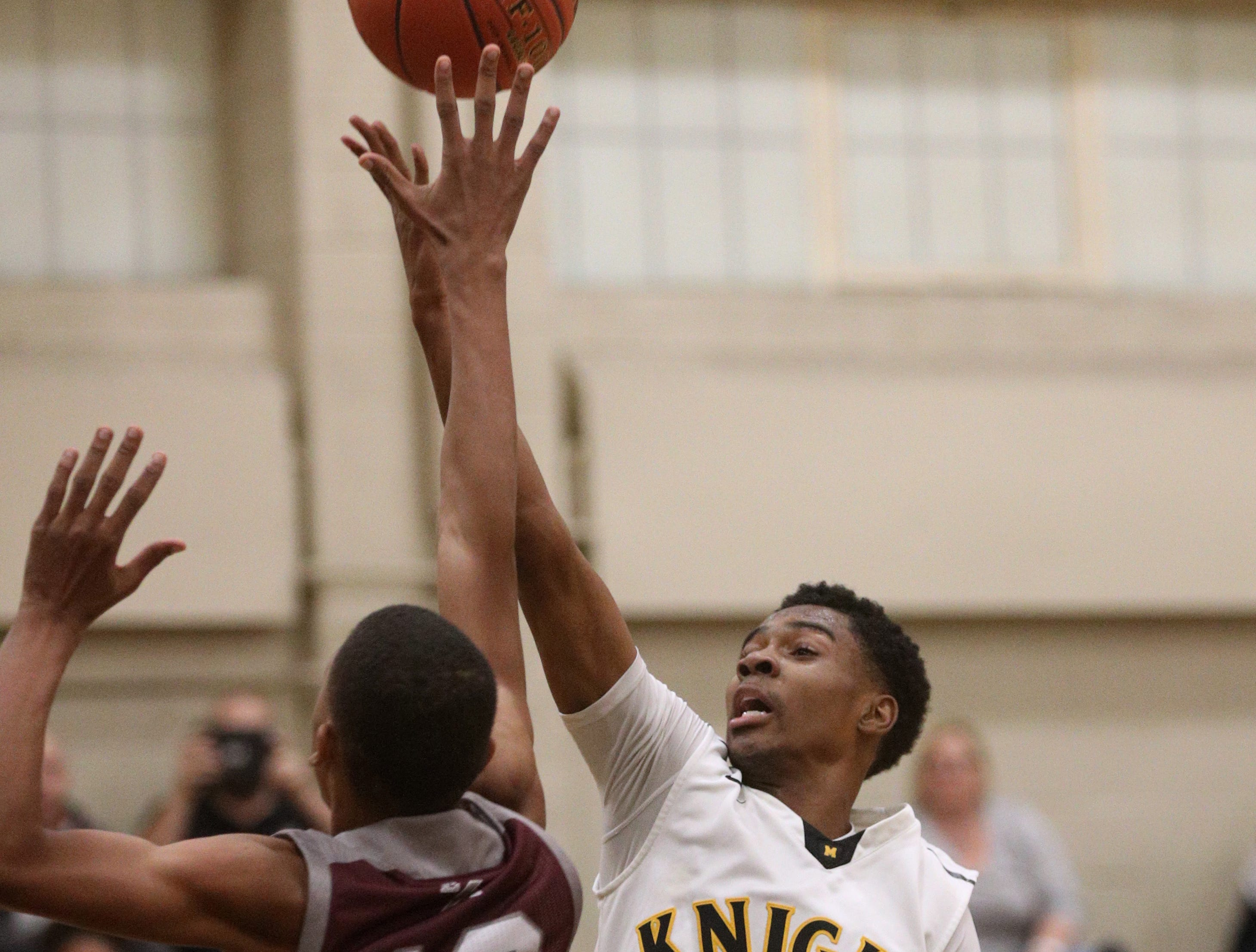 McQuaid's Kobe Long  (30) drives to the basket over Edison's Javonte McKnight.
