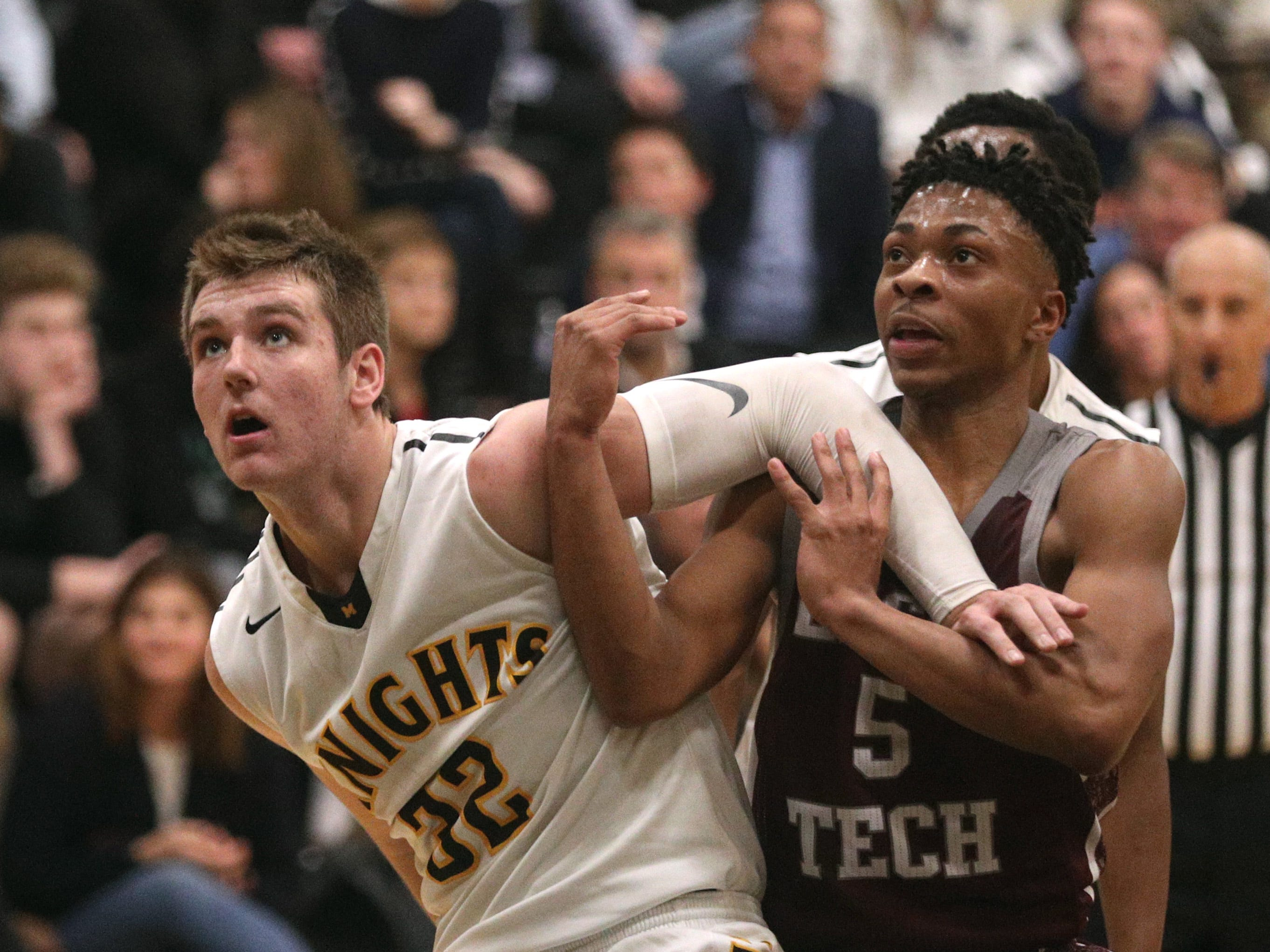 McQuaid's  Connor Zamiara and Edison's Alton Knight fight for position  for a rebound.