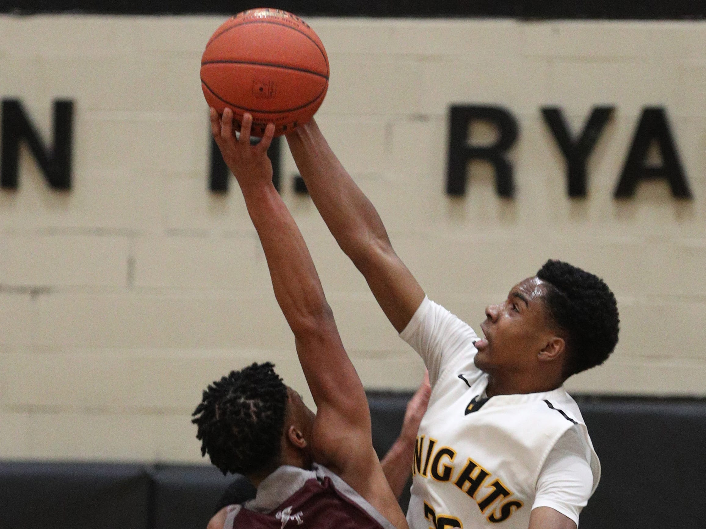 McQuaid's Kobe Long (30) gets the block on a shot by Edison's Alton Knight.