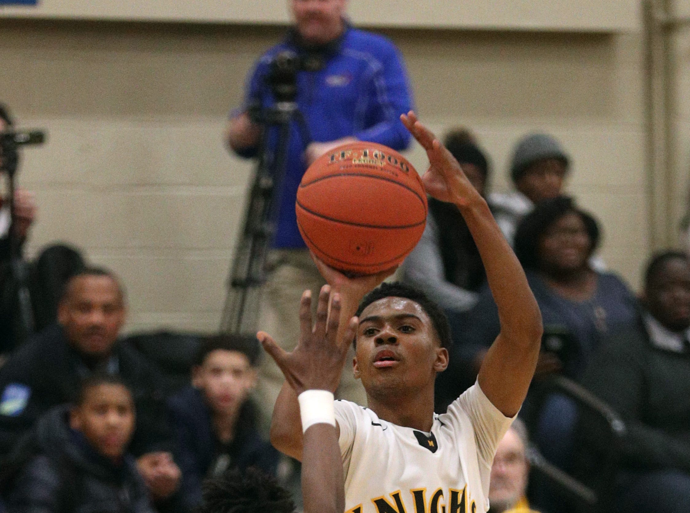 McQuaid's Kobe Long shoots a 3-pointer over Edison's Edgar Bass lV.