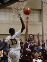 Edison's Alton Knight shoots over McQuaid's Rueben Daniel (13).