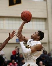 McQuaid's Jermaine Taggart drives to the basket.