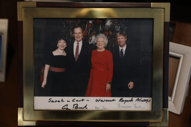 Photo of Curt Smith and his wife Sarah with George and Barbara Bush, which they keep at their Chili home.
