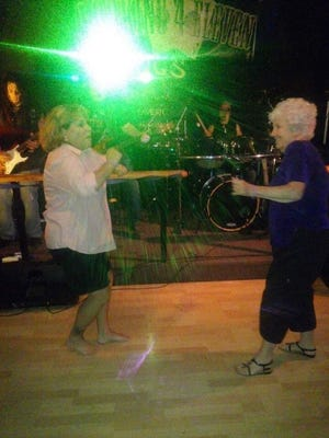 Carol Souza, left, and Joan Tracy dance in this contributed picture. Tracy, 82, died in the Camp Fire.