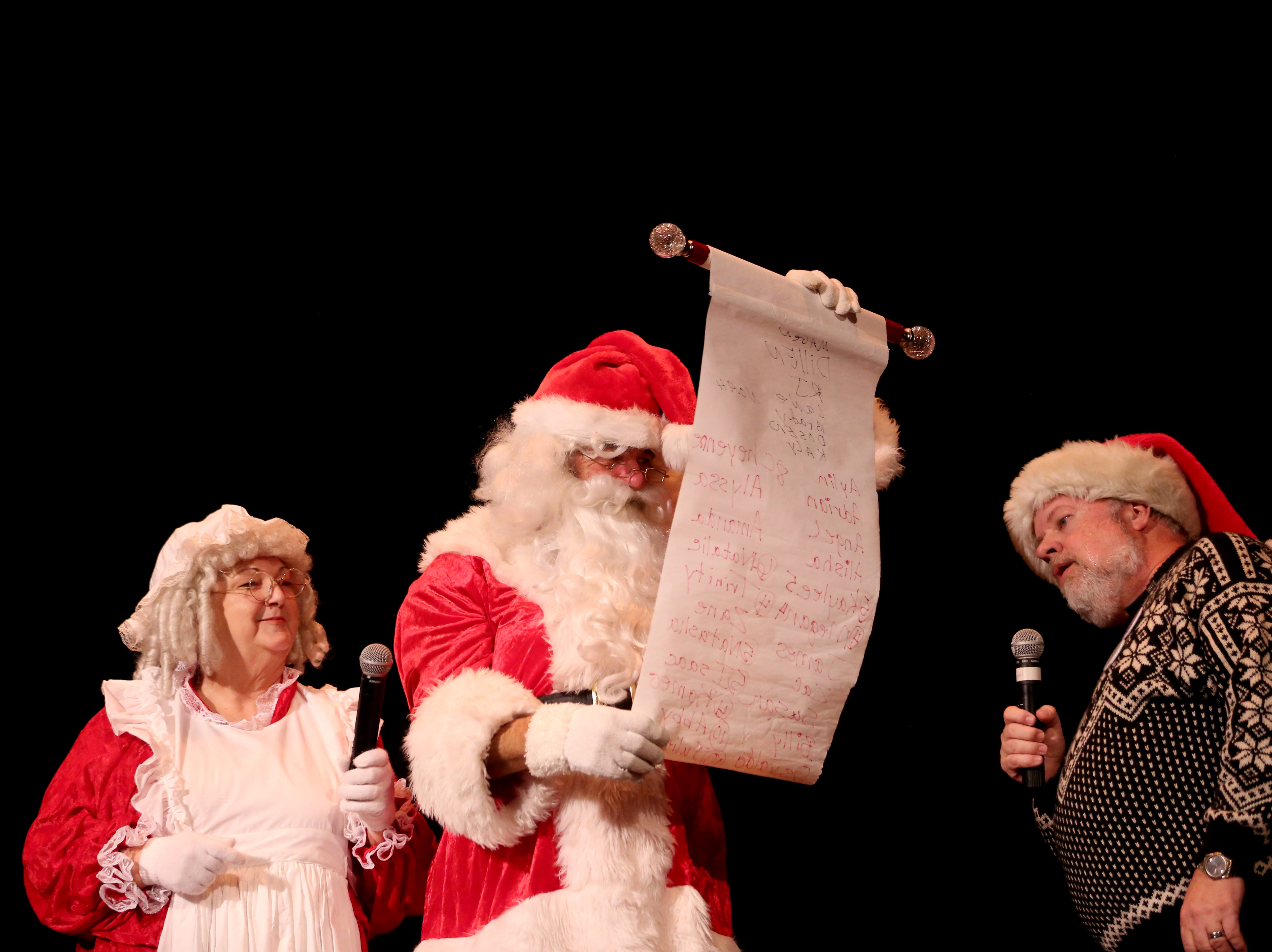 Santa Claus and Mrs. Claus read a list of good names at the 78th annual children's holiday party at the Elsinore Theatre on Saturday, Dec. 1, 2018. The party included holiday music and a visit from Santa.