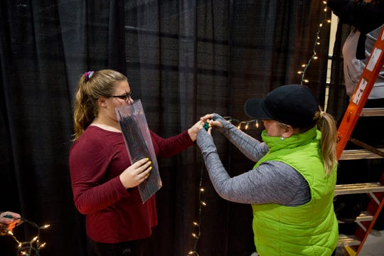 "Members of Willamette Academy, a coalition of students from the Salem-Keizer schools, set up for the 65th annual Snoball at the Oregon State Fairgrounds and Exposition Center on Friday, Nov. 30, 2018. This years theme is ""Old Hollywood Glam."""