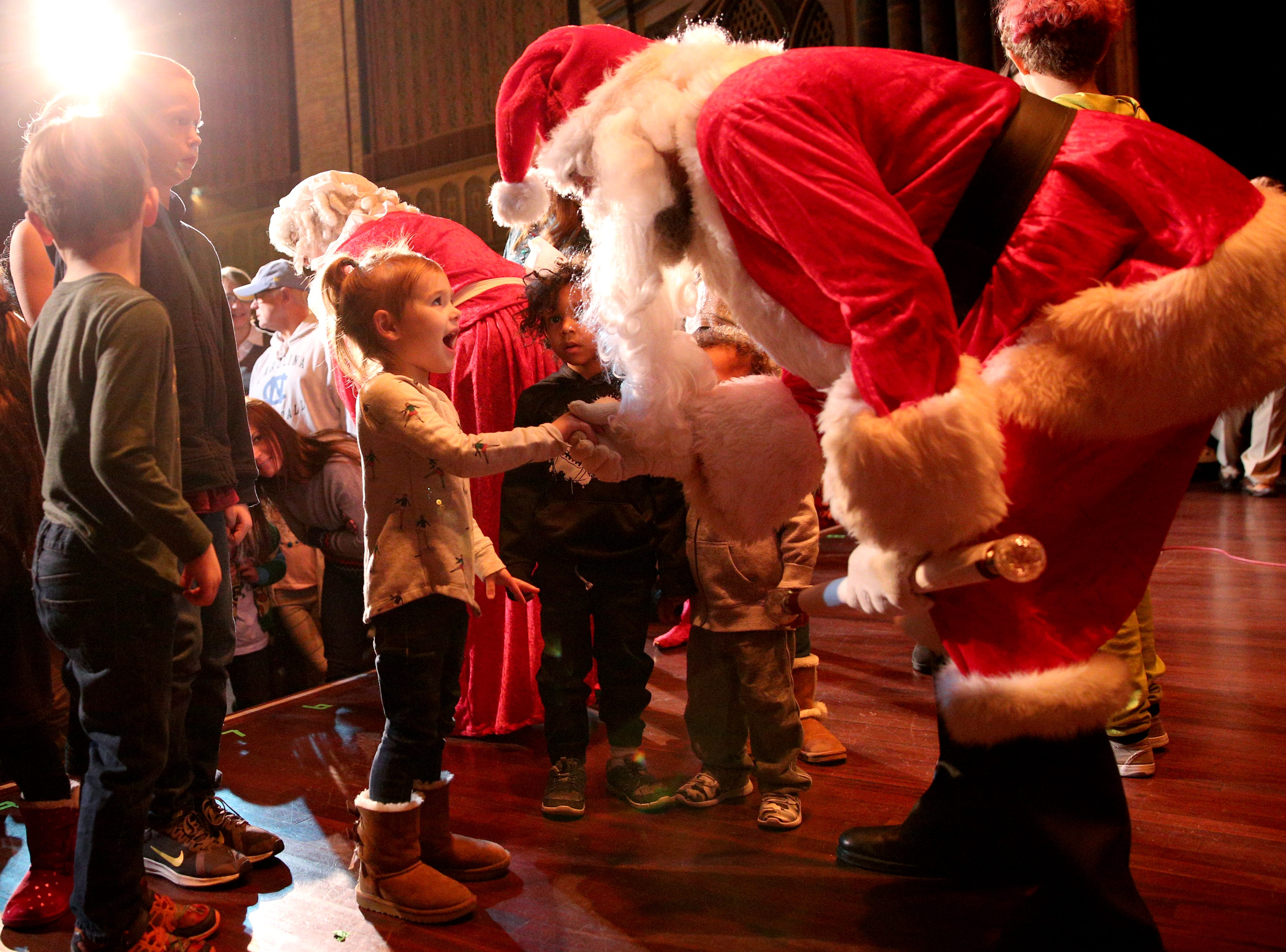 Santa Claus greets children and listens to their wishes at the 78th annual children's holiday party at the Elsinore Theatre on Saturday, Dec. 1, 2018. The party included holiday music and a visit from Santa.