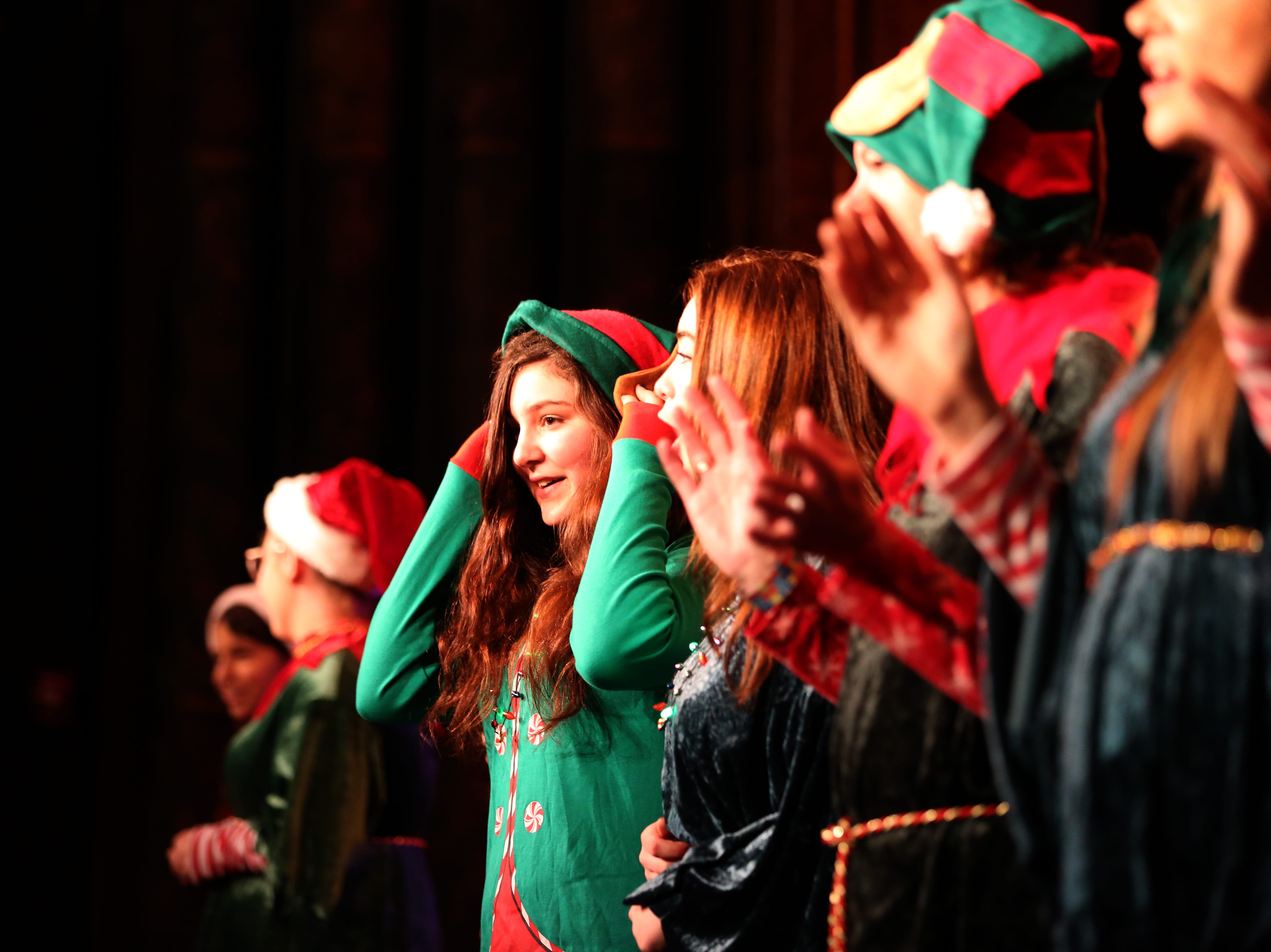 Elves come on stage before Santa Claus at the 78th annual children's holiday party at the Elsinore Theatre on Saturday, Dec. 1, 2018. The party included holiday music and a visit from Santa.