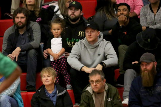 Former McKay High School head football coach Josh Riddell watches the McKay vs. North Salem basketball game at North Salem High School on Friday, Nov. 30, 2018.  Some fans in attendance showed their support for Riddle who recently learned his contract would not be renewed.