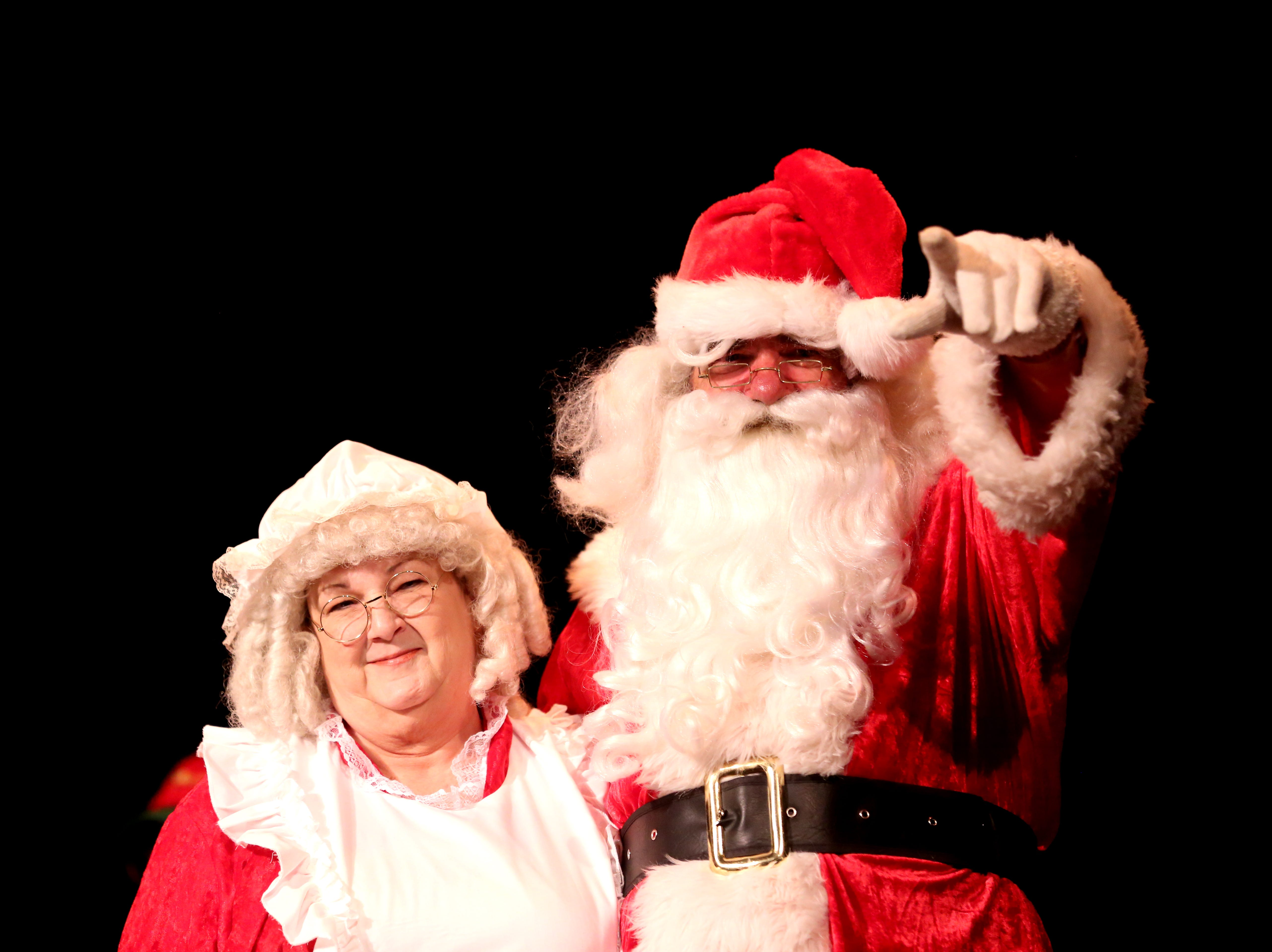 Santa Claus and Mrs. Claus greet children at the 78th annual children's holiday party at the Elsinore Theatre on Saturday, Dec. 1, 2018. The party included holiday music and a visit from Santa.