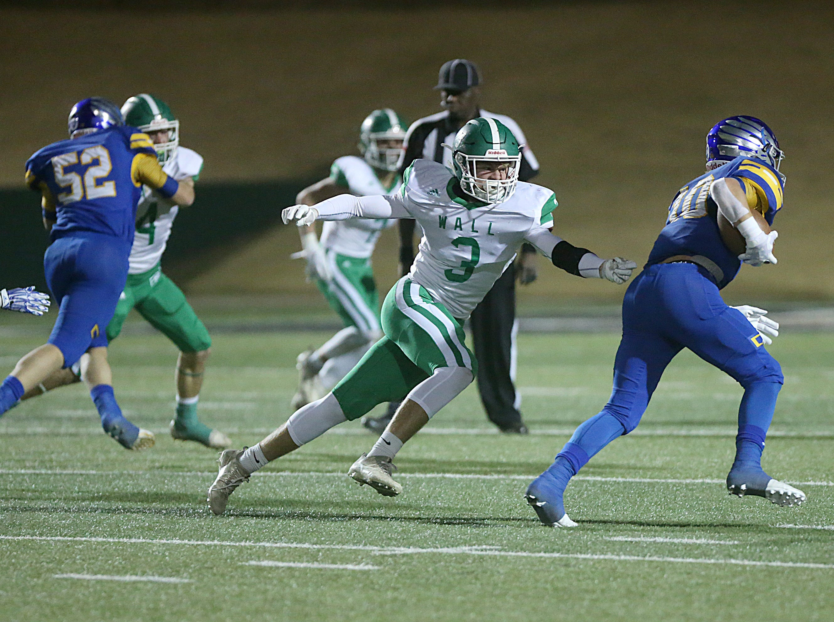 Wall's Joe Walker (#3) chases down Brock's Toby Morrison (#10) Friday, Nov. 30, 2018, during their game at Shotwell Stadium in Abilene. Wall lost 13 to 35.