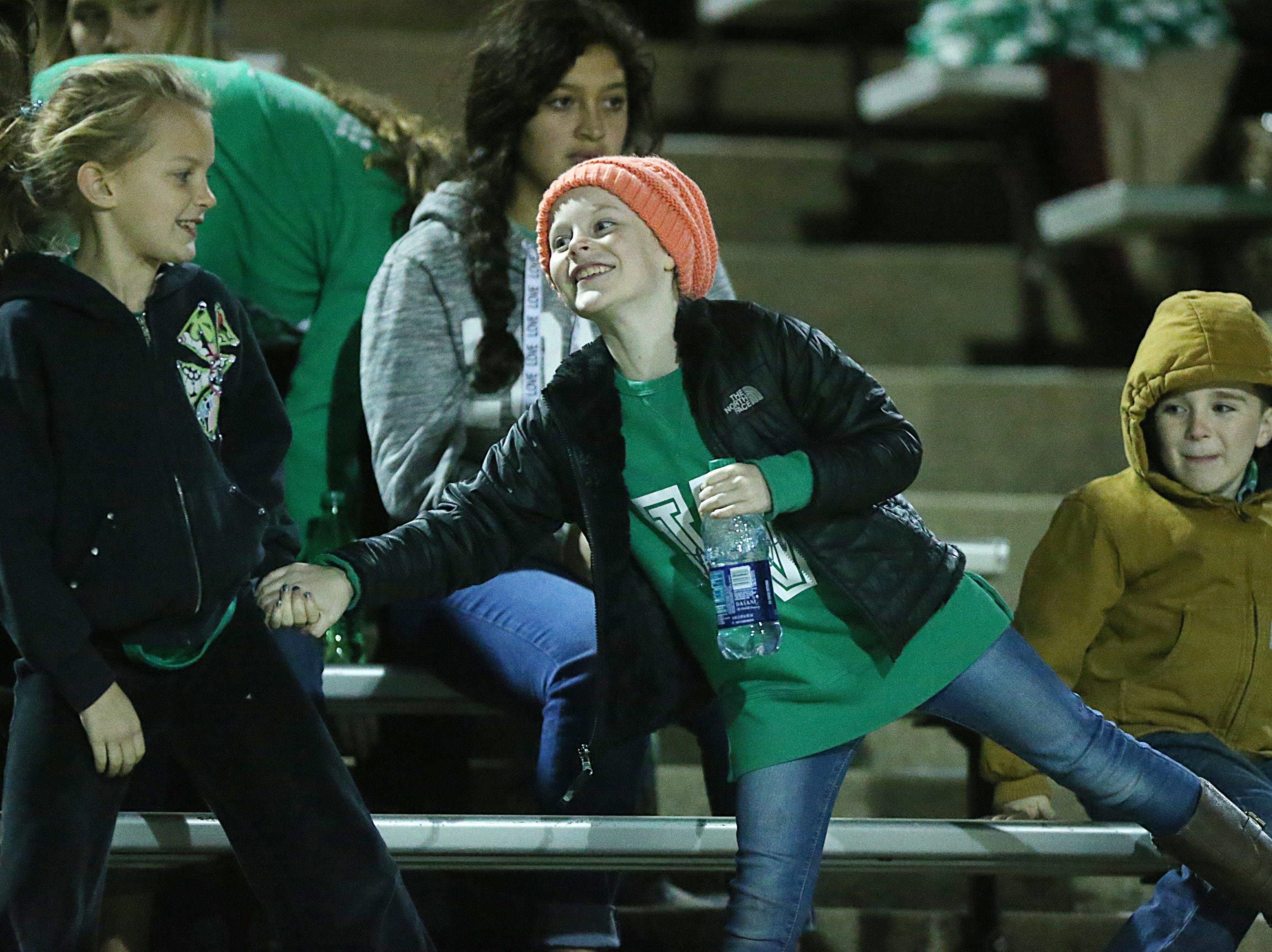 Young Wall fans play around in the stands Friday, Nov. 30, 2018, during the Wall Hawks game against the Brock Eagles at Shotwell Stadium in Abilene. Wall lost 13 to 35.