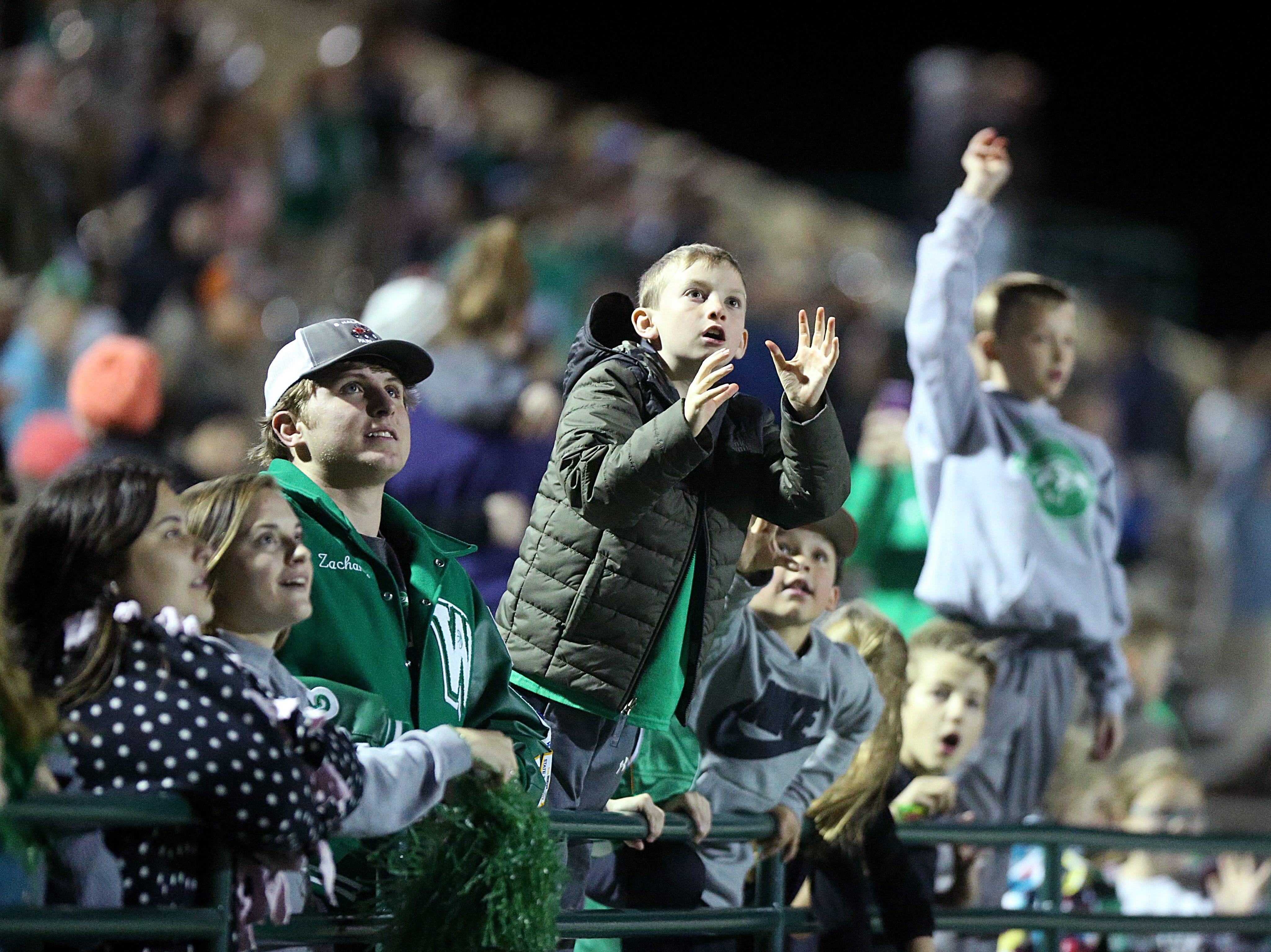 Wall fans prepare to grab T-shirts thrown into the crowd by the cheerleaders Friday, Nov. 30, 2018, at the game between the Wall Hawks and the Brock Eagles at Shotwell Stadium in Abilene. Wall lost 13 to 35.