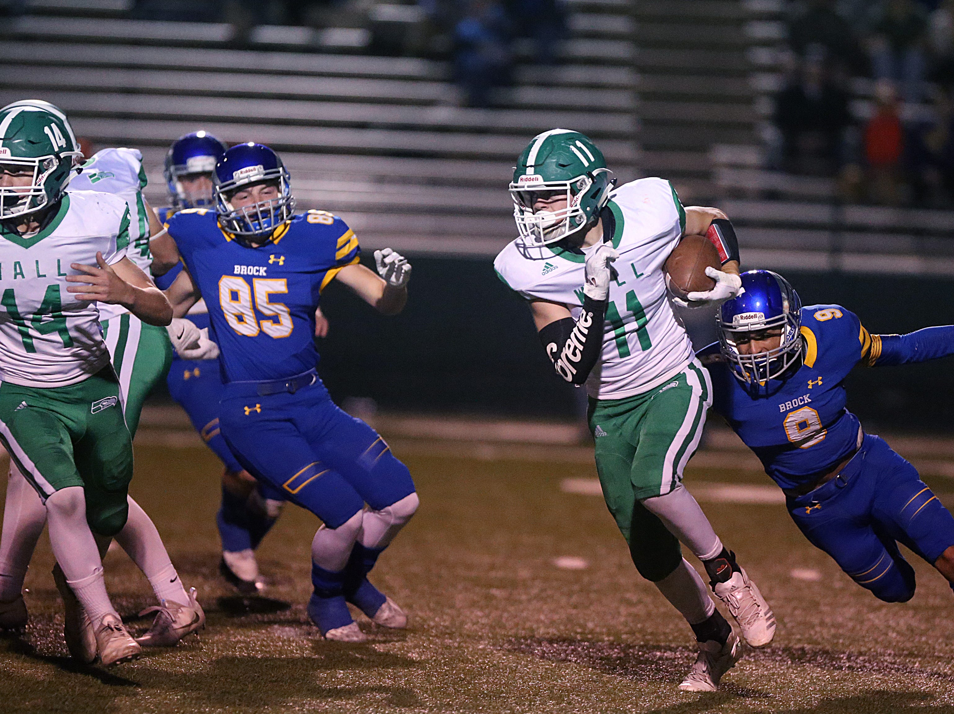 Wall's Coleman Coon (#11) tries to outrun Brock's Kaden Hendrix (#9) Friday, Nov. 30, 2018, during their game at Shotwell Stadium in Abilene. Wall lost 13 to 35.