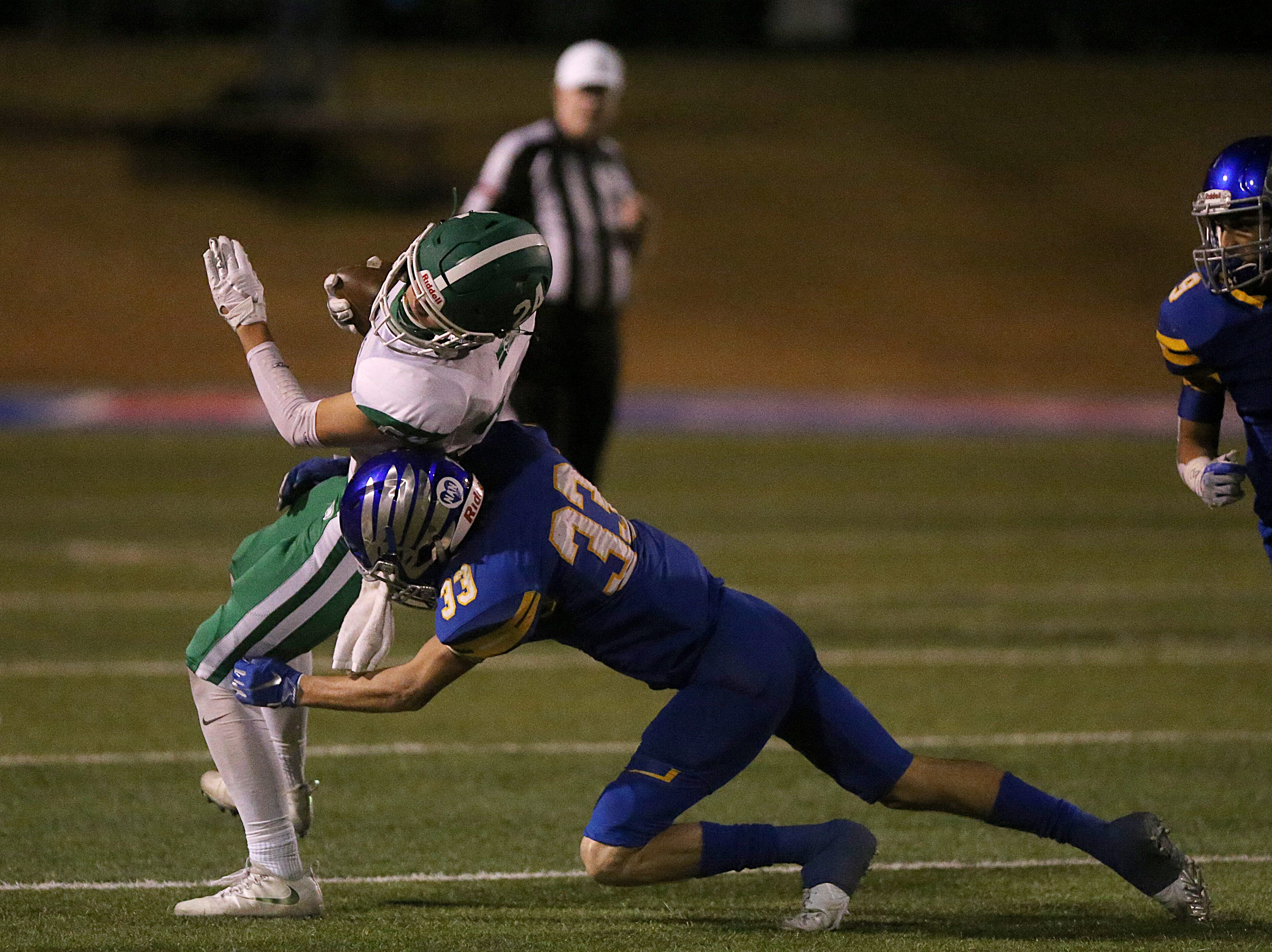 Wall's Kye Herbert (#24) tries to spin his way out of a tackle from Brock's Tommy Merrill (#33) Friday, Nov. 30, 2018, during their game at Shotwell Stadium in Abilene. Wall lost 13 to 35.