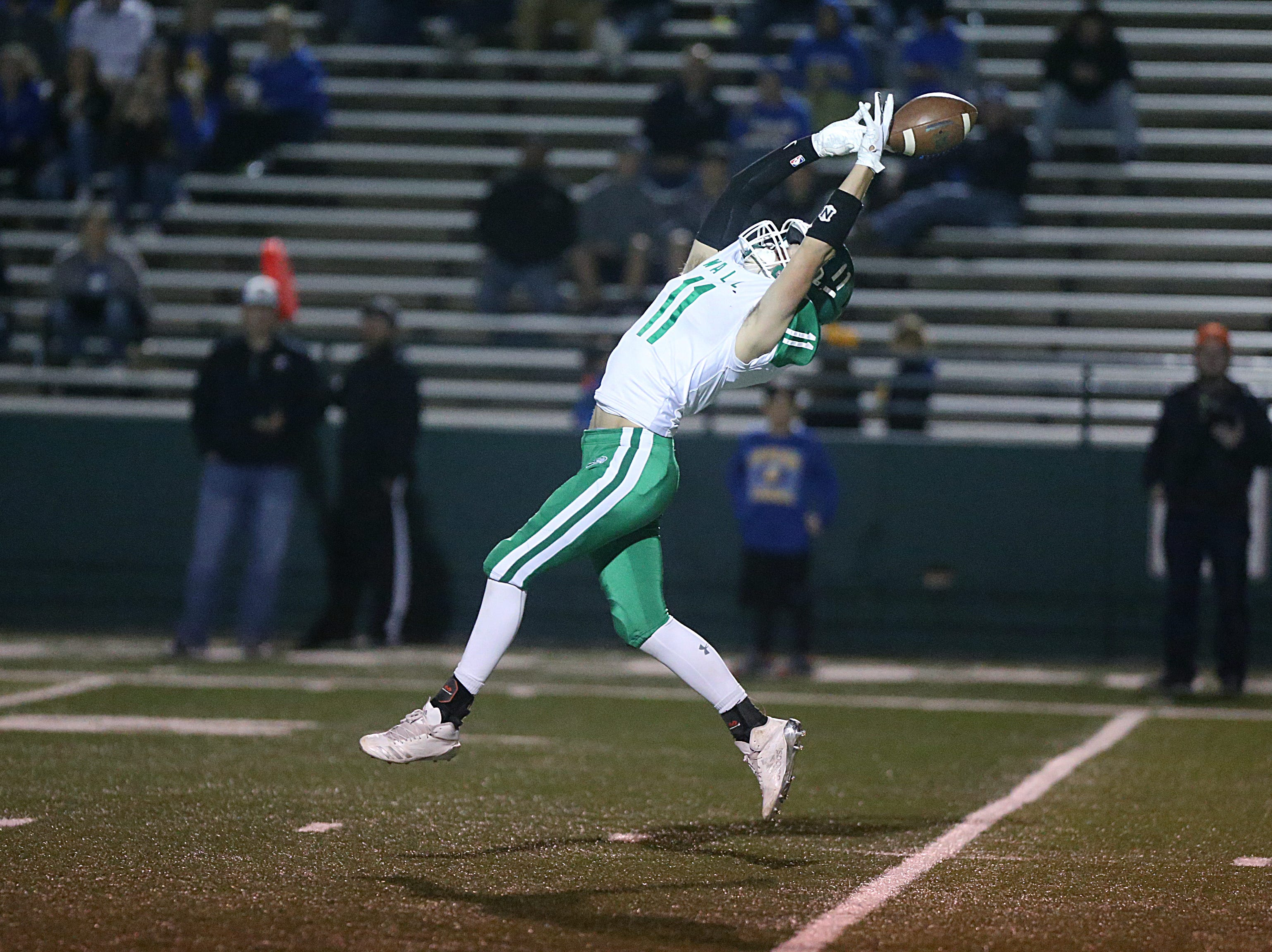 Wall's Coleman Coon (#11) misses a pass Friday, Nov. 30, 2018, during their game against the Brock Eagles at Shotwell Stadium in Abilene. Wall lost 13 to 35.