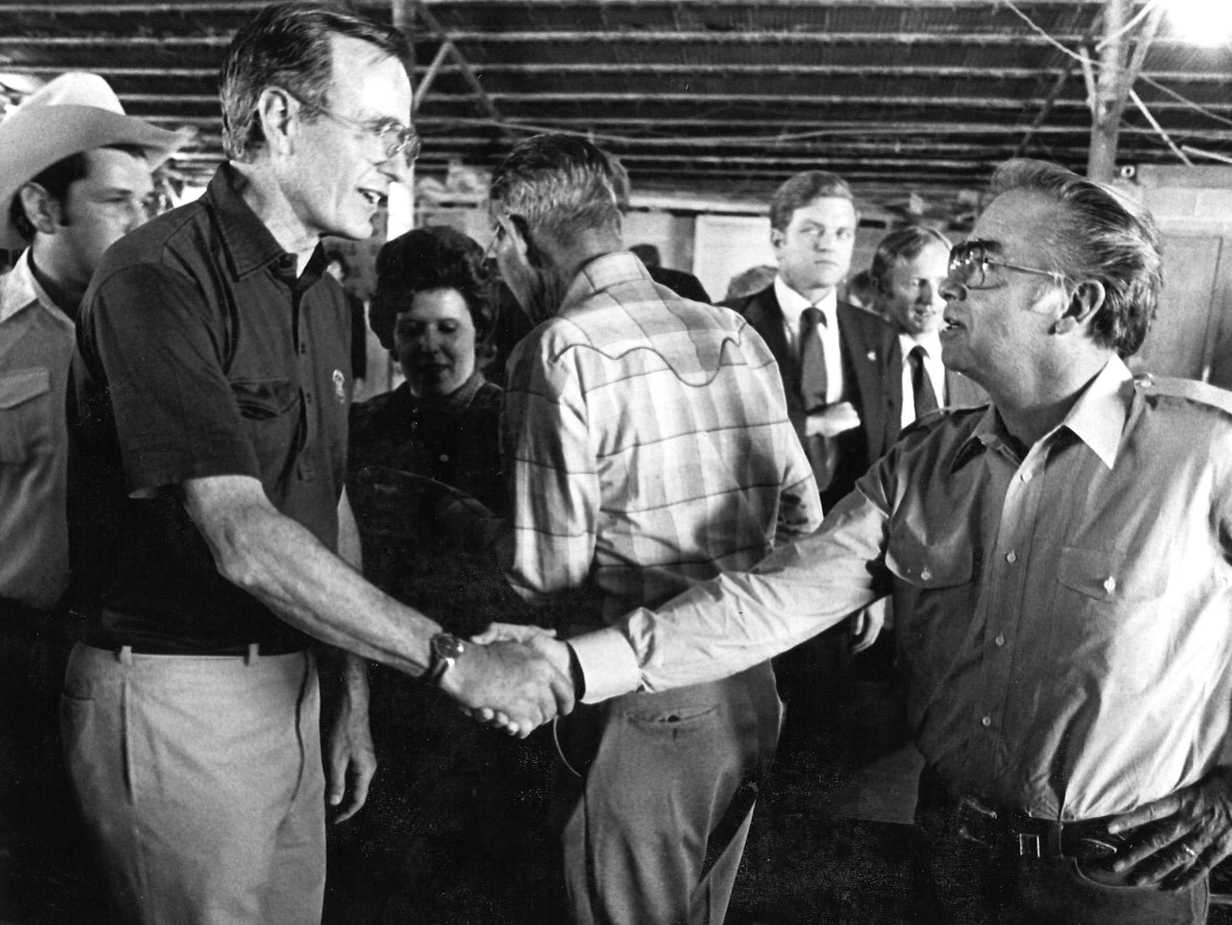 Vice President George Bush greets a guest at a barbecue on Oct. 16, 1982 in Pecos.