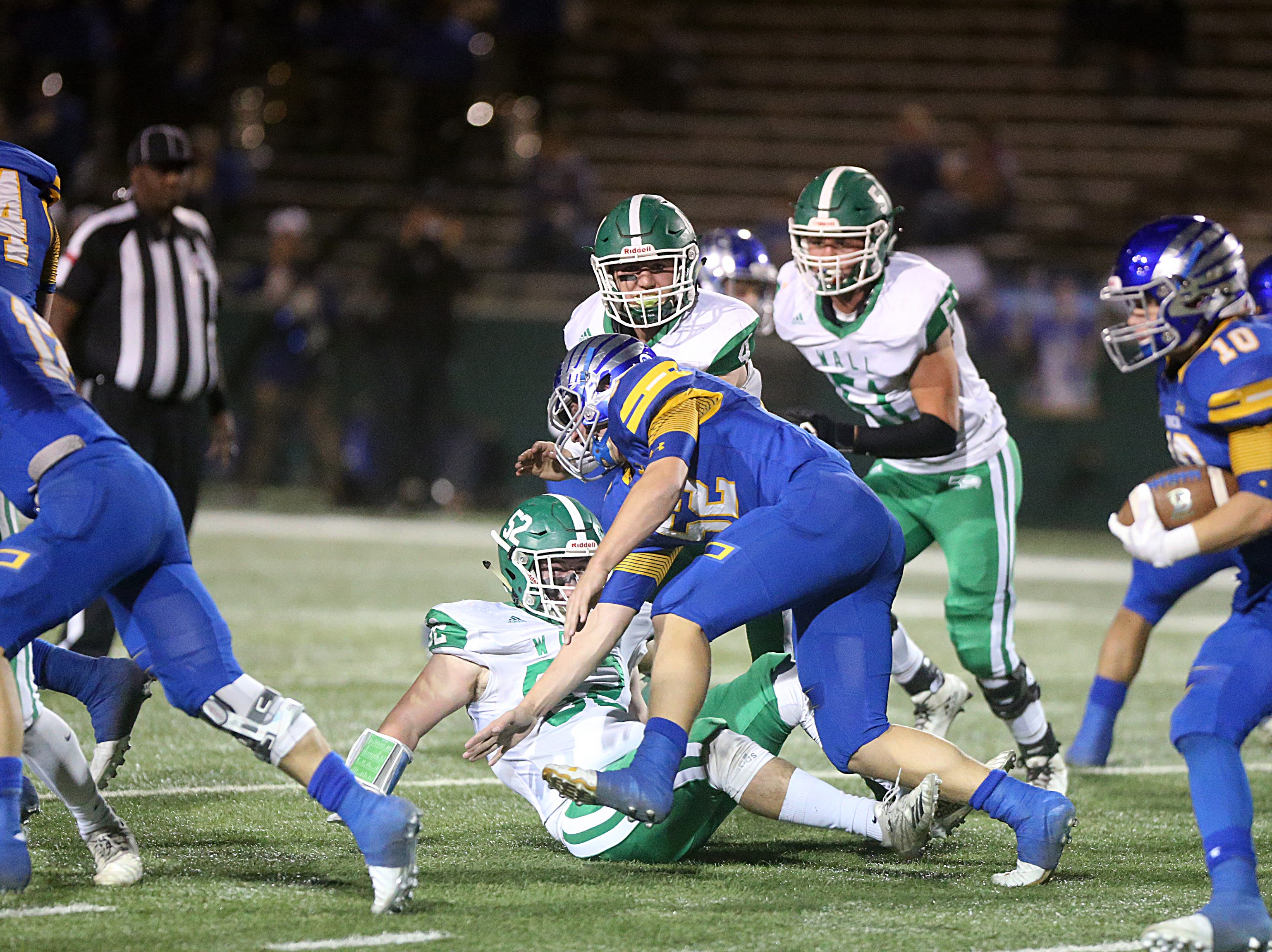 The Wall Hawks and the Brock Eagles collided on the field Friday, Nov. 30, 2018, during their game at Shotwell Stadium in Abilene. Wall lost 13 to 35.