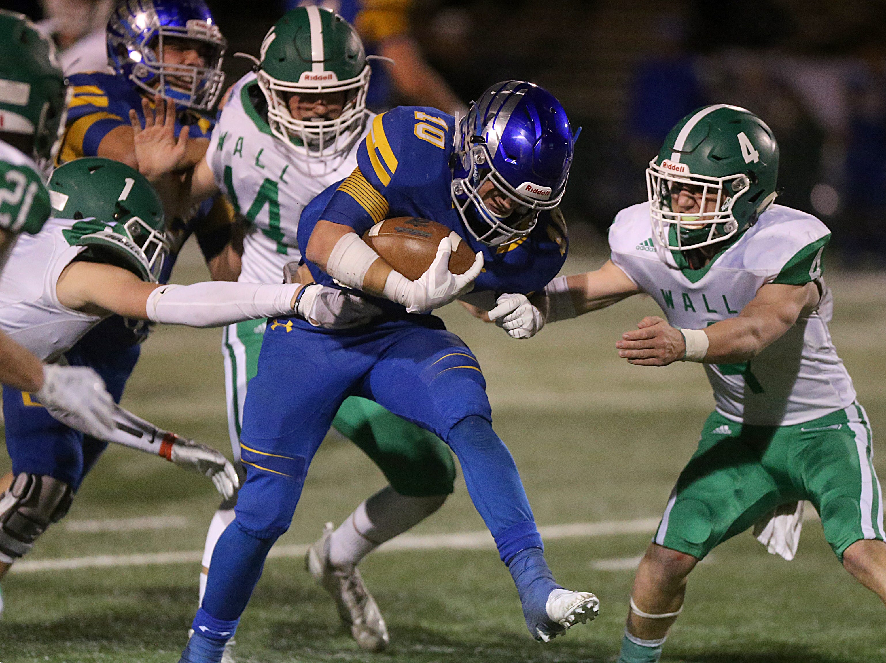 Brock's Toby Morrison (#10) is tackled by several Wall players Friday, Nov. 30, 2018, during their game at Shotwell Stadium in Abilene. Wall lost 13 to 35.