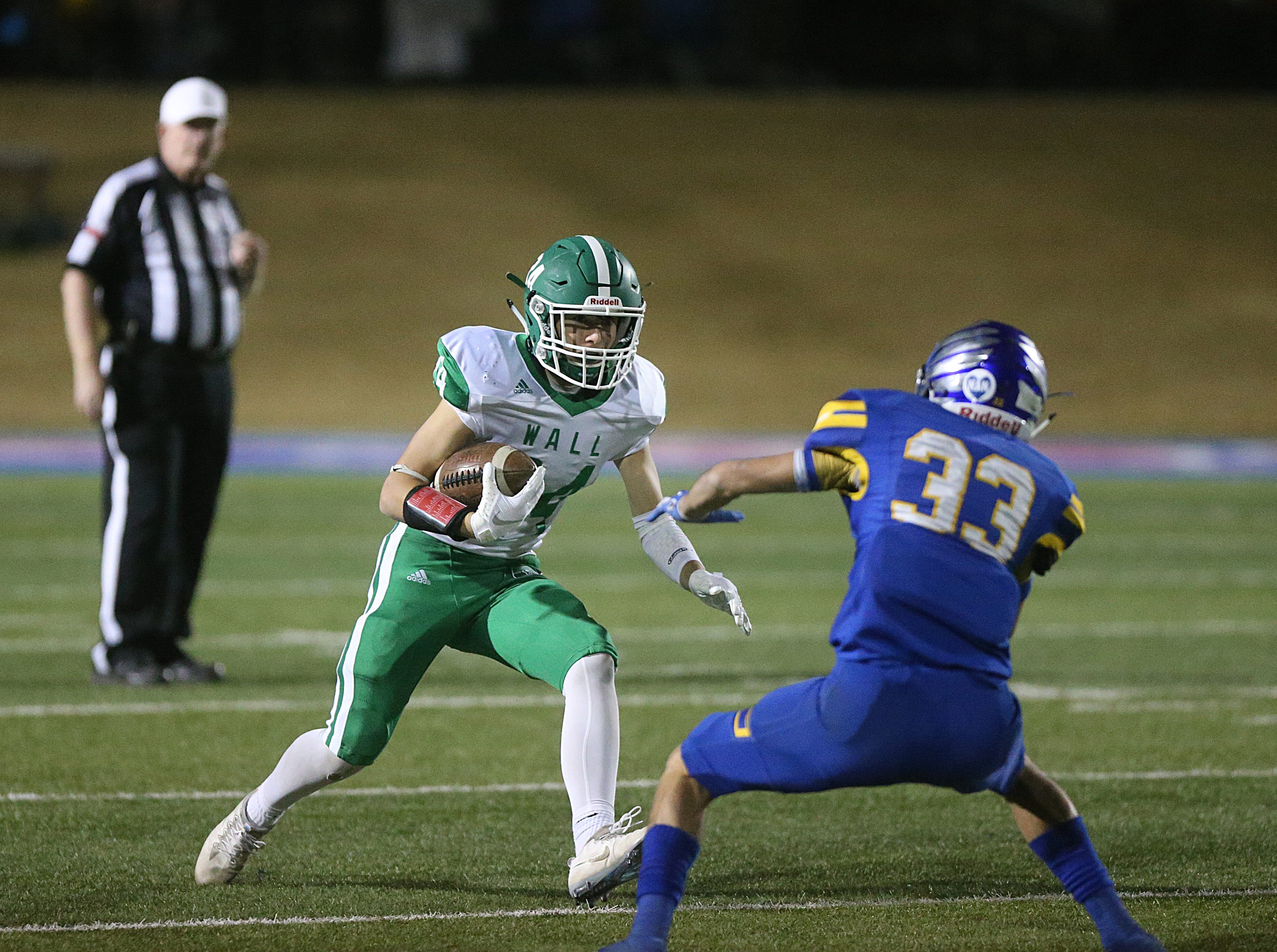 Wall's Kye Herbert (#24) tries to maneuver past Brock's Tommy Merrill (#33) Friday, Nov. 30, 2018, during their game at Shotwell Stadium in Abilene. Wall lost 13 to 35.