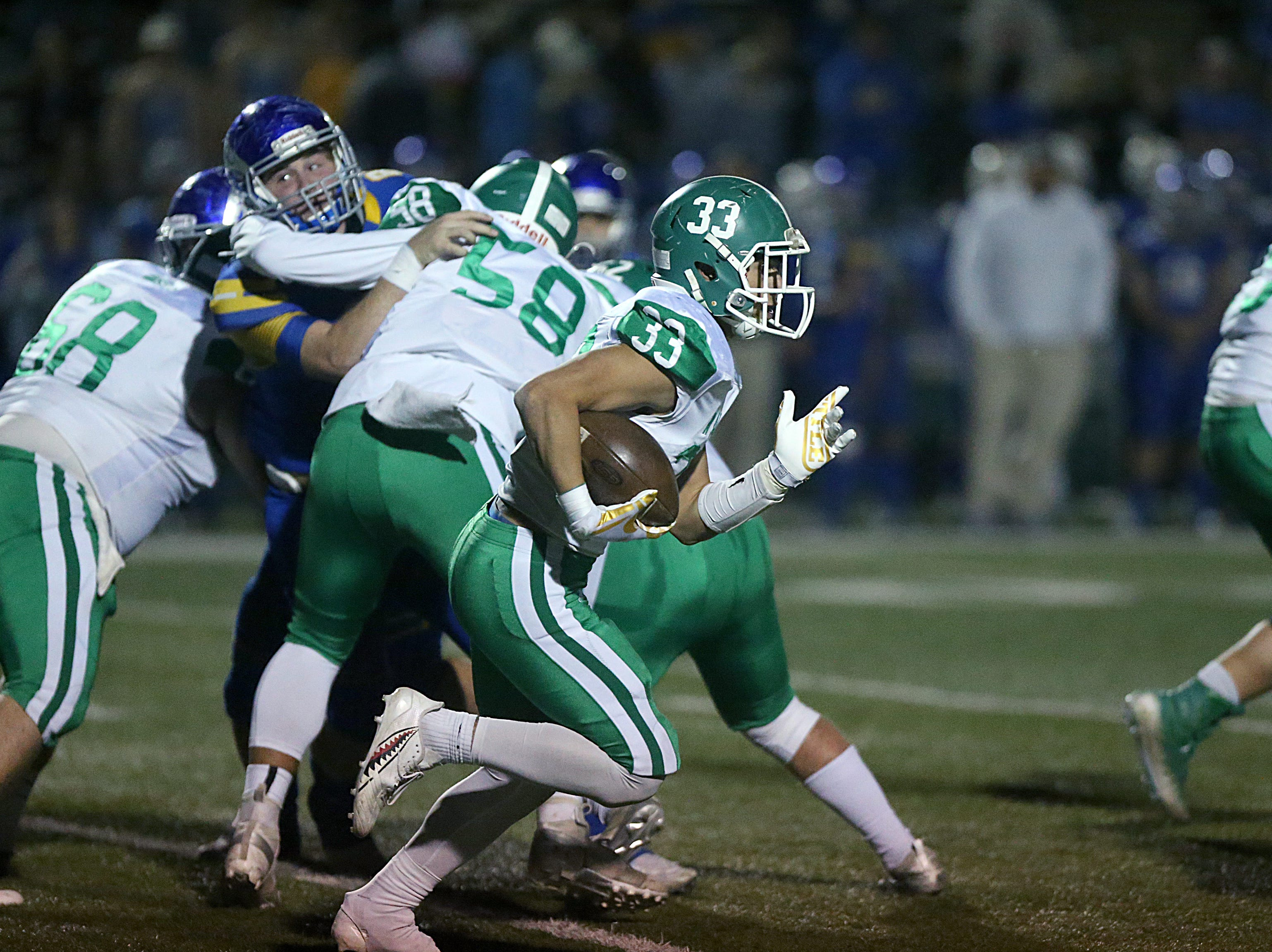 Wall's Chase Rios (#33) rushes downfield as his teammates provide defense Friday, Nov. 30, 2018, against the Brock Eagles at Shotwell Stadium in Abilene. Wall lost 13 to 35.