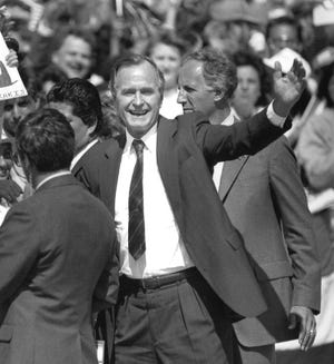 Presidential candidate George Bush waves to the crowd after his arrival at Midland Airport in October 1988 on a campaign swing through West Texas.